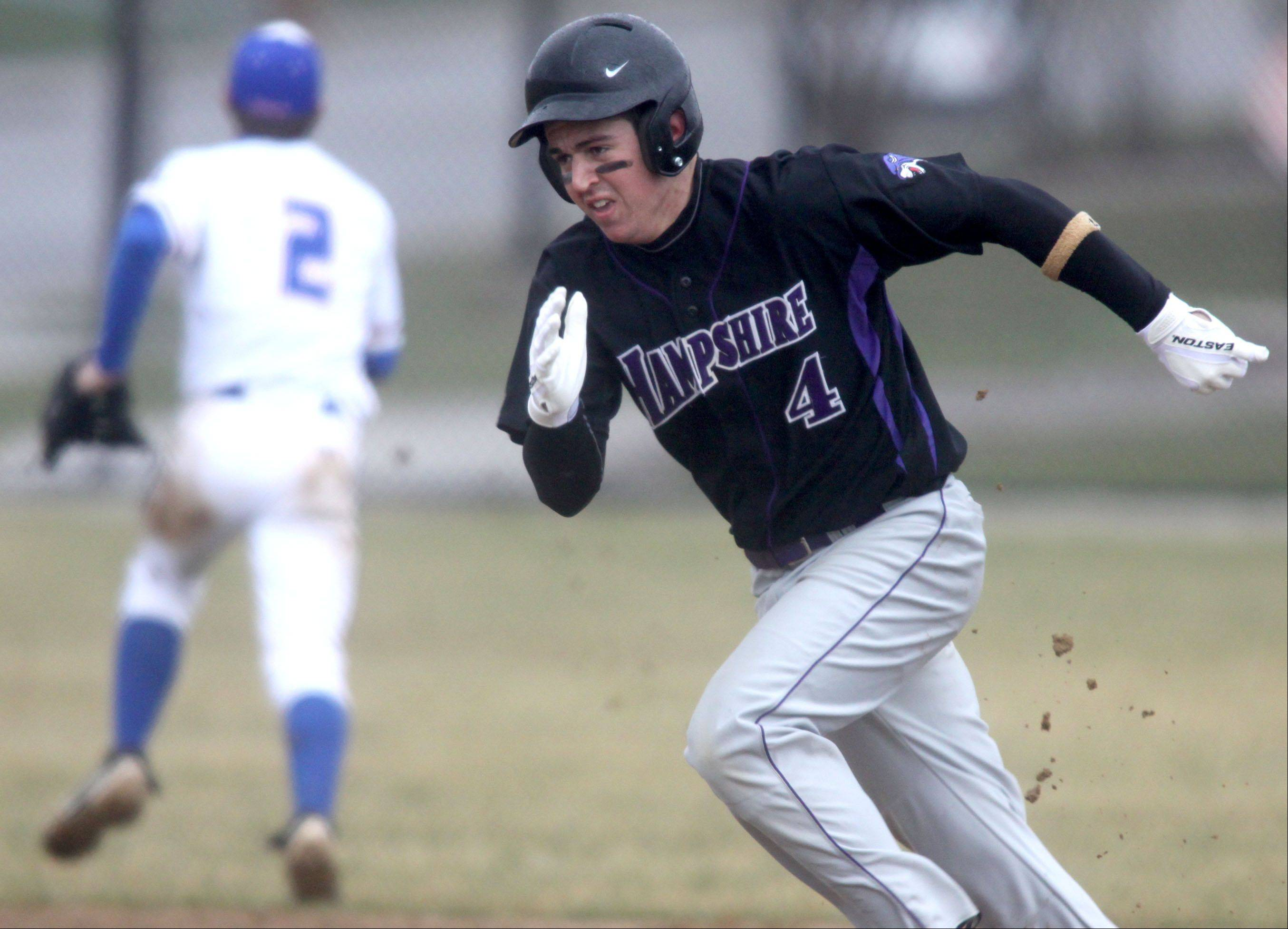 Hampshire's Michael Laramie dashes toward third base against Dundee-Crown during a varsity baseball game at Carpentersville on Friday.
