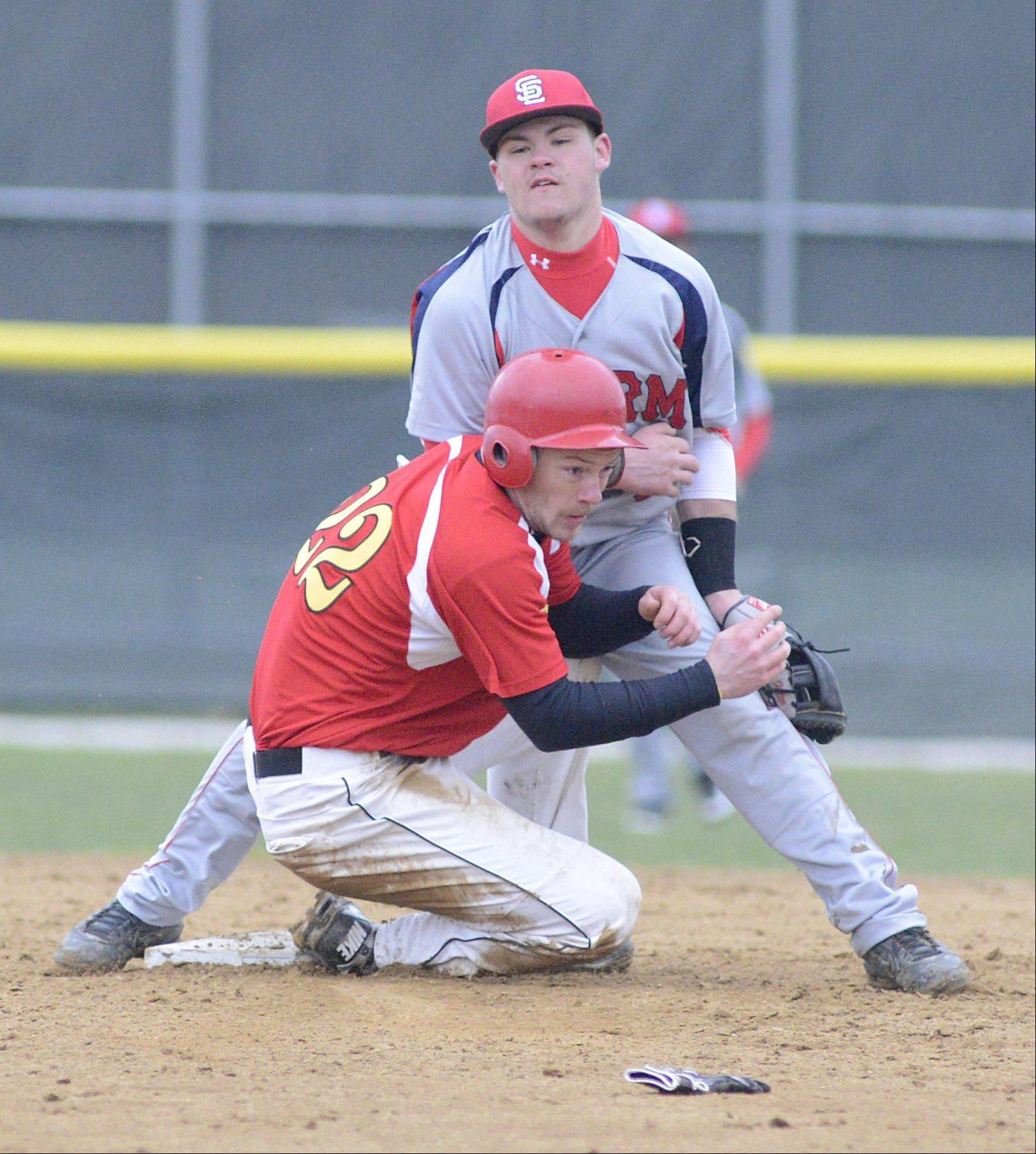 Batavia's Robbie Bowman stops just short of colliding with South Elgin's Riley Halter at second base Friday at Batavia.