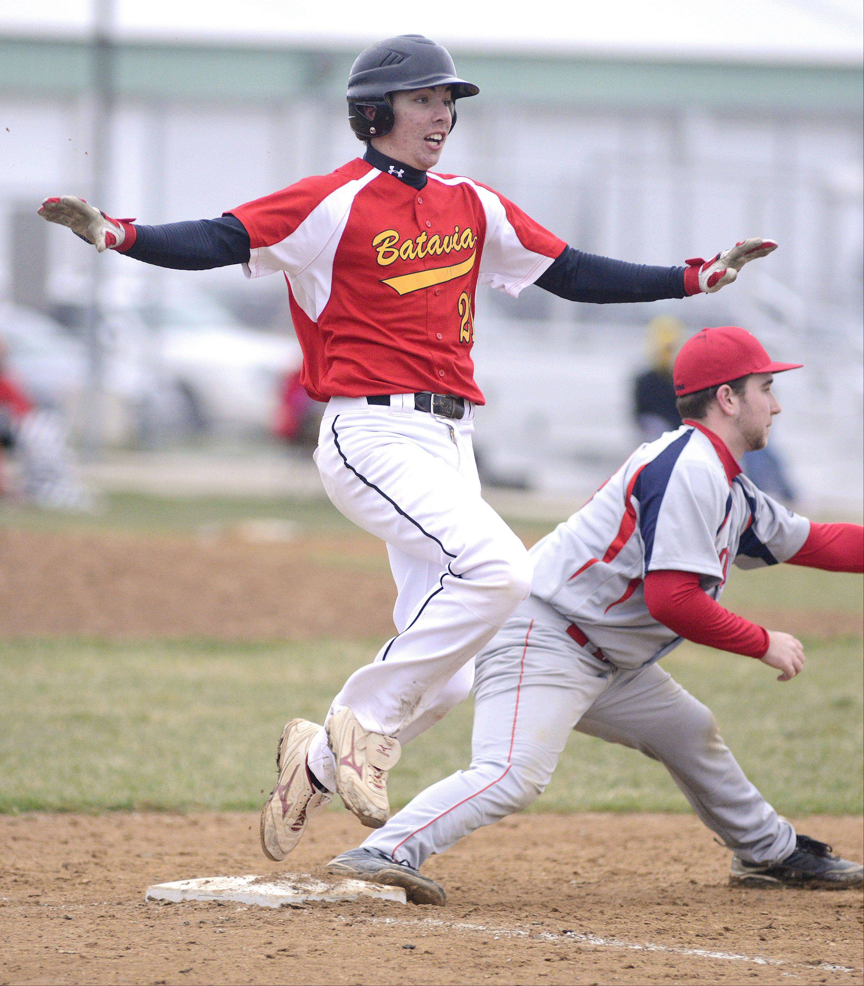 Batavia's Jeremy Schoessling hits the first base bag just as the ball hits the mitt of South Elgin's Alex Wolfe in the fifth inning on Friday at Batavia.