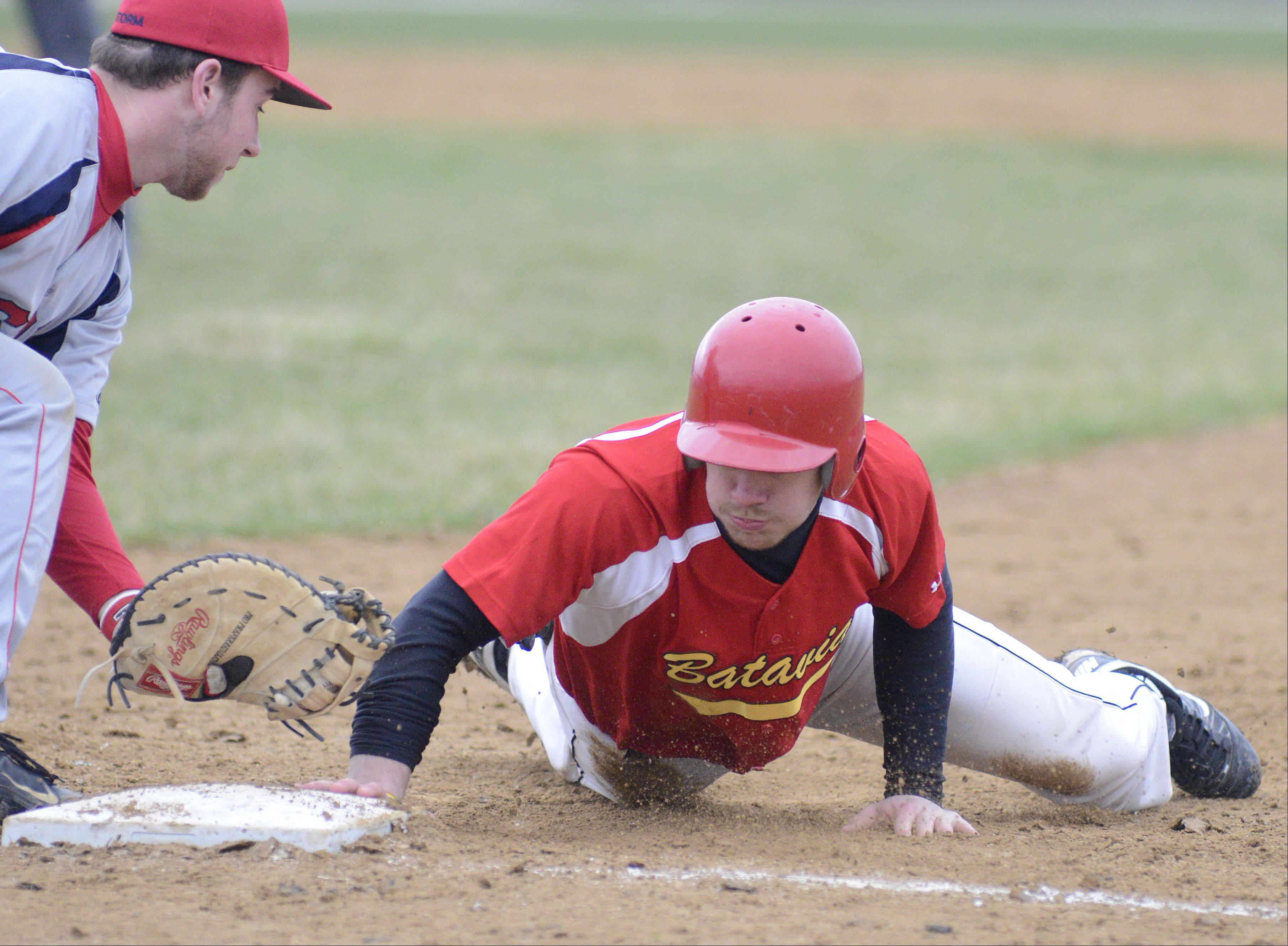 South Elgin's Alex Wolfe is just a second too late from tagging out Batavia's Robbie Bowman at first base Friday.