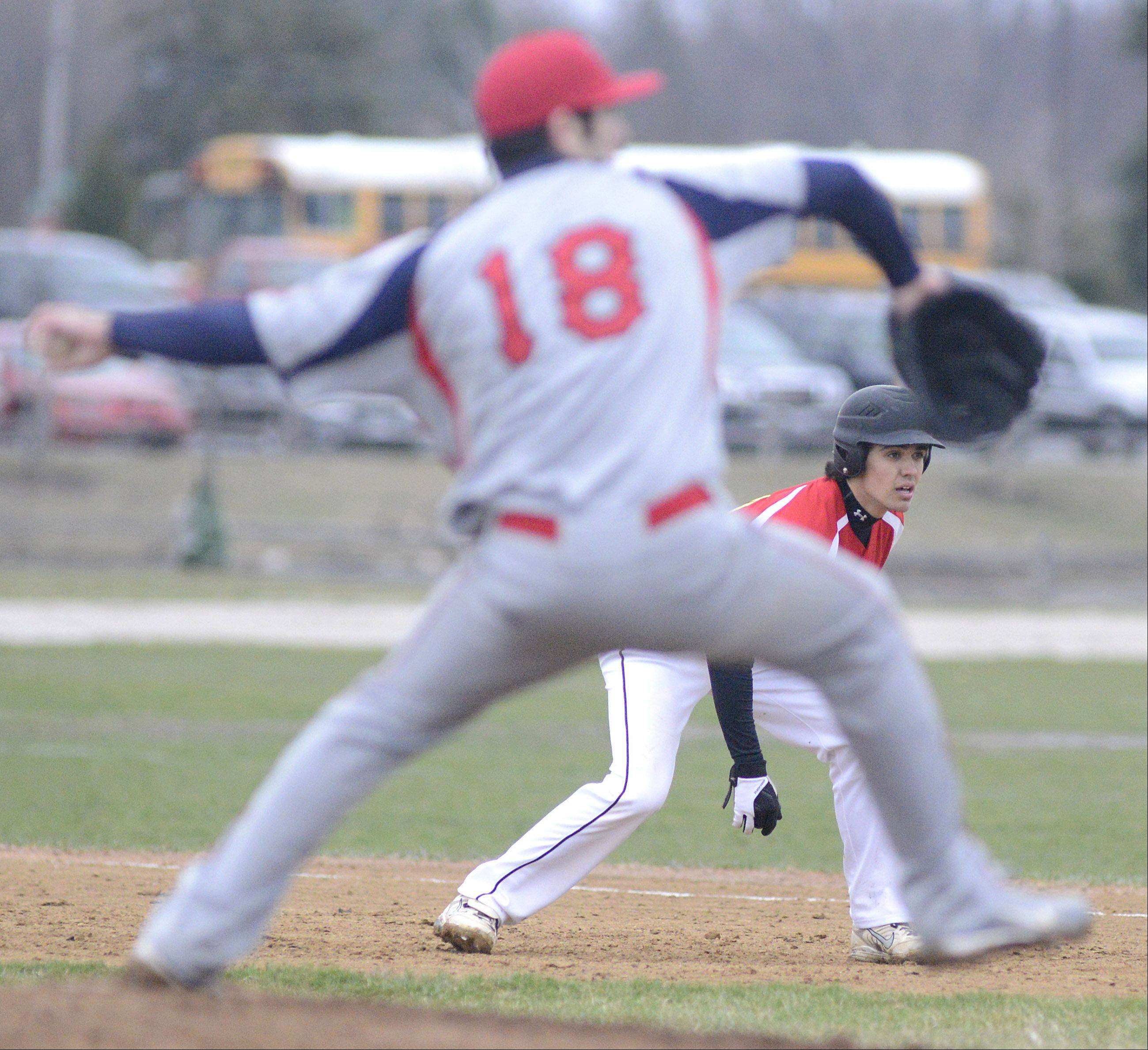 Batavia's Micah Coffey keeps his eye on the batter Friday as South Elgin's Joe Crivolio delivers.