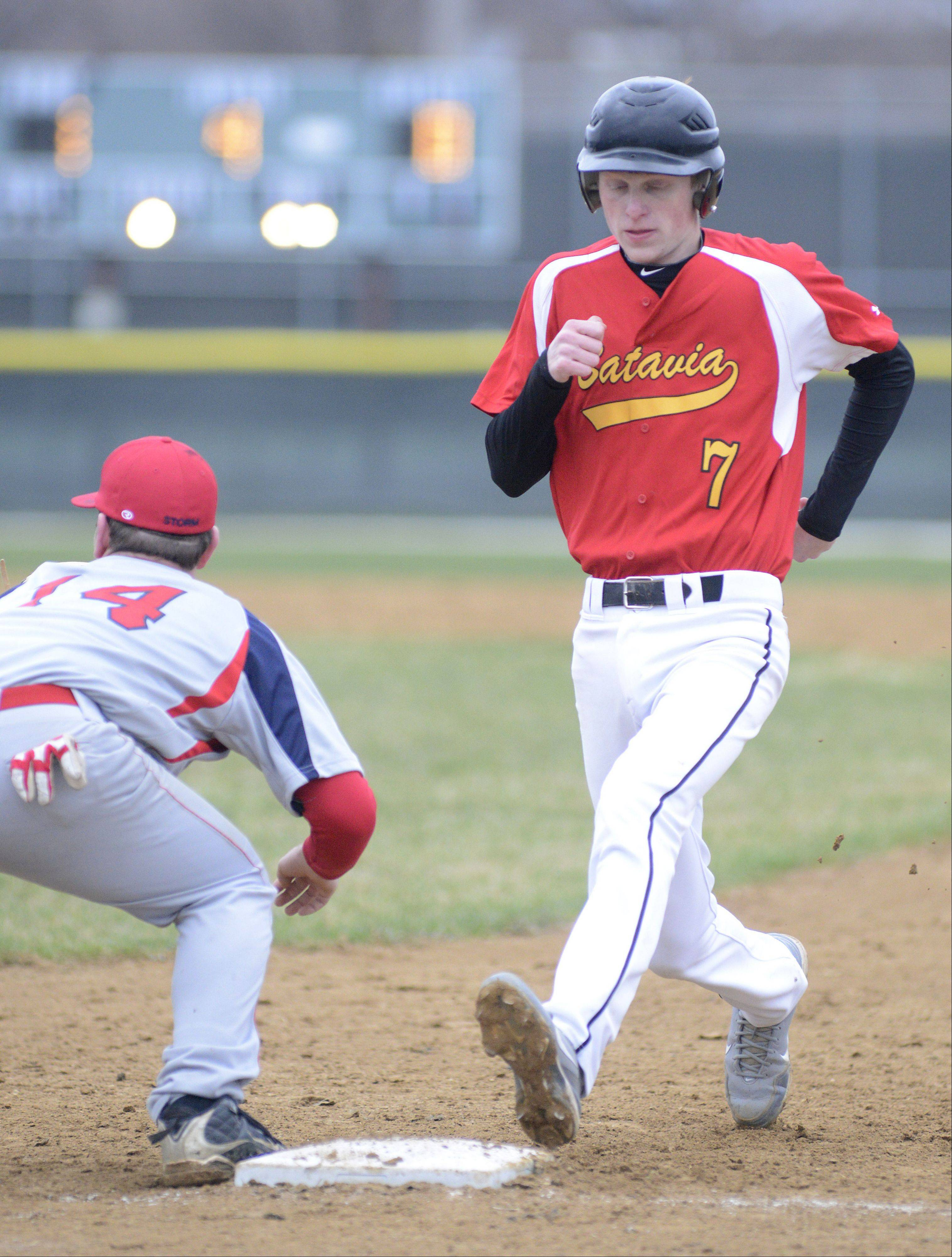 Batavia's Andre Seigler trots safely back to first base before South Elgin's Alex Wolfe can get the ball on Friday, April 12.