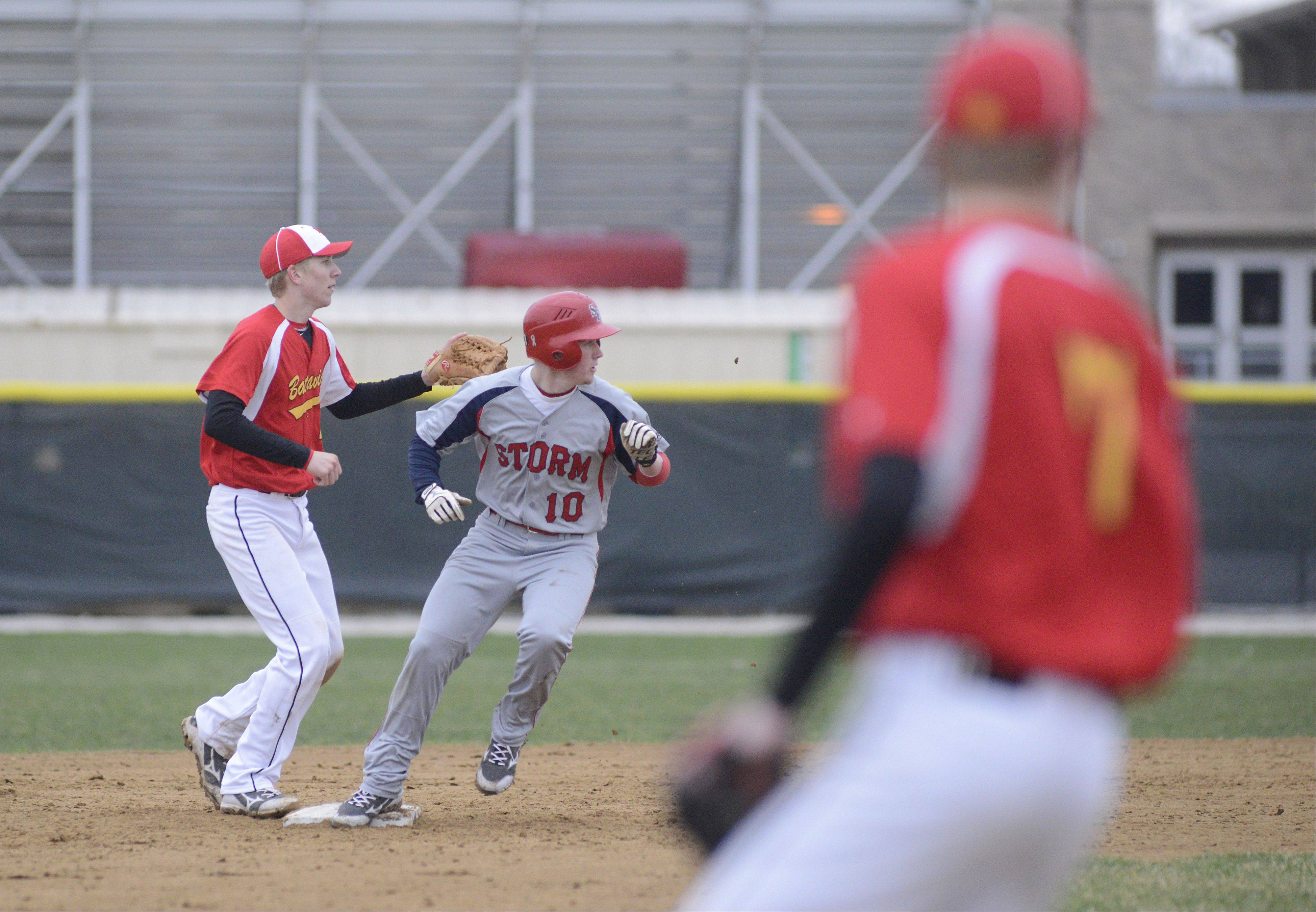 South Elgin's Tyler Thorsen is safe on second base from Batavia's Billy Zwick in the third inning on Friday, April 12.