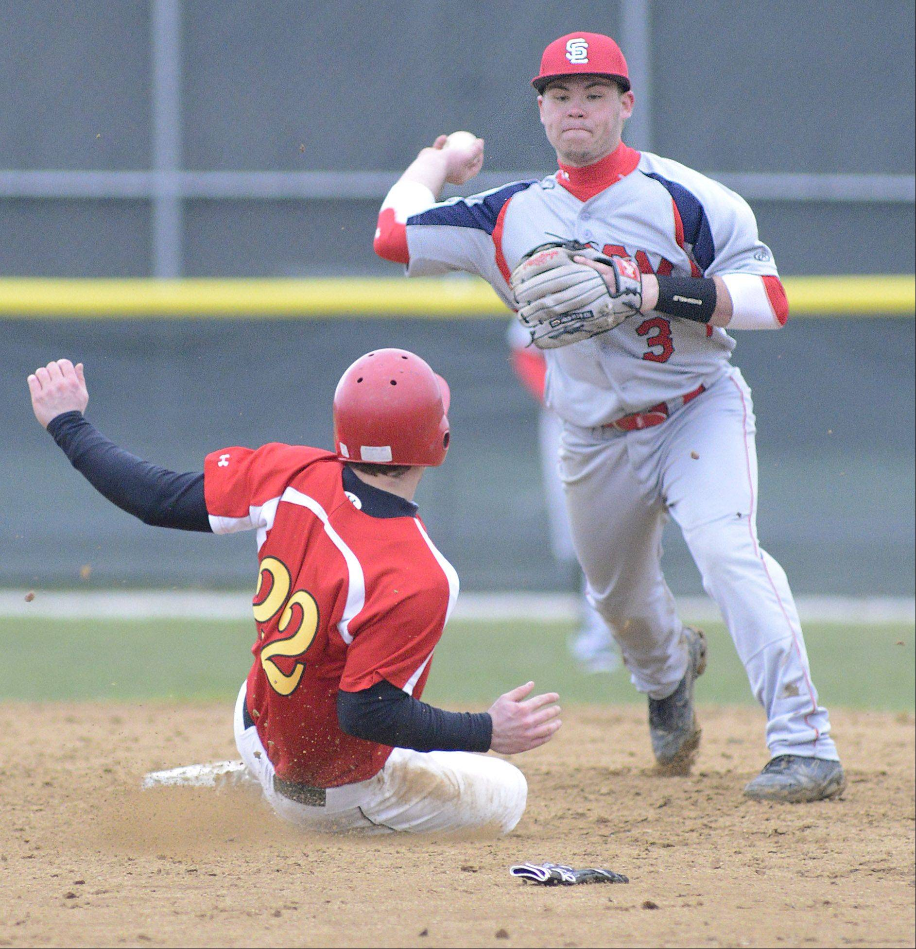 Batavia's Robbie Bowman is out at second as South Elgin's Riley Halter attempts a double play at first base in the fourth inning on Friday, April 12.