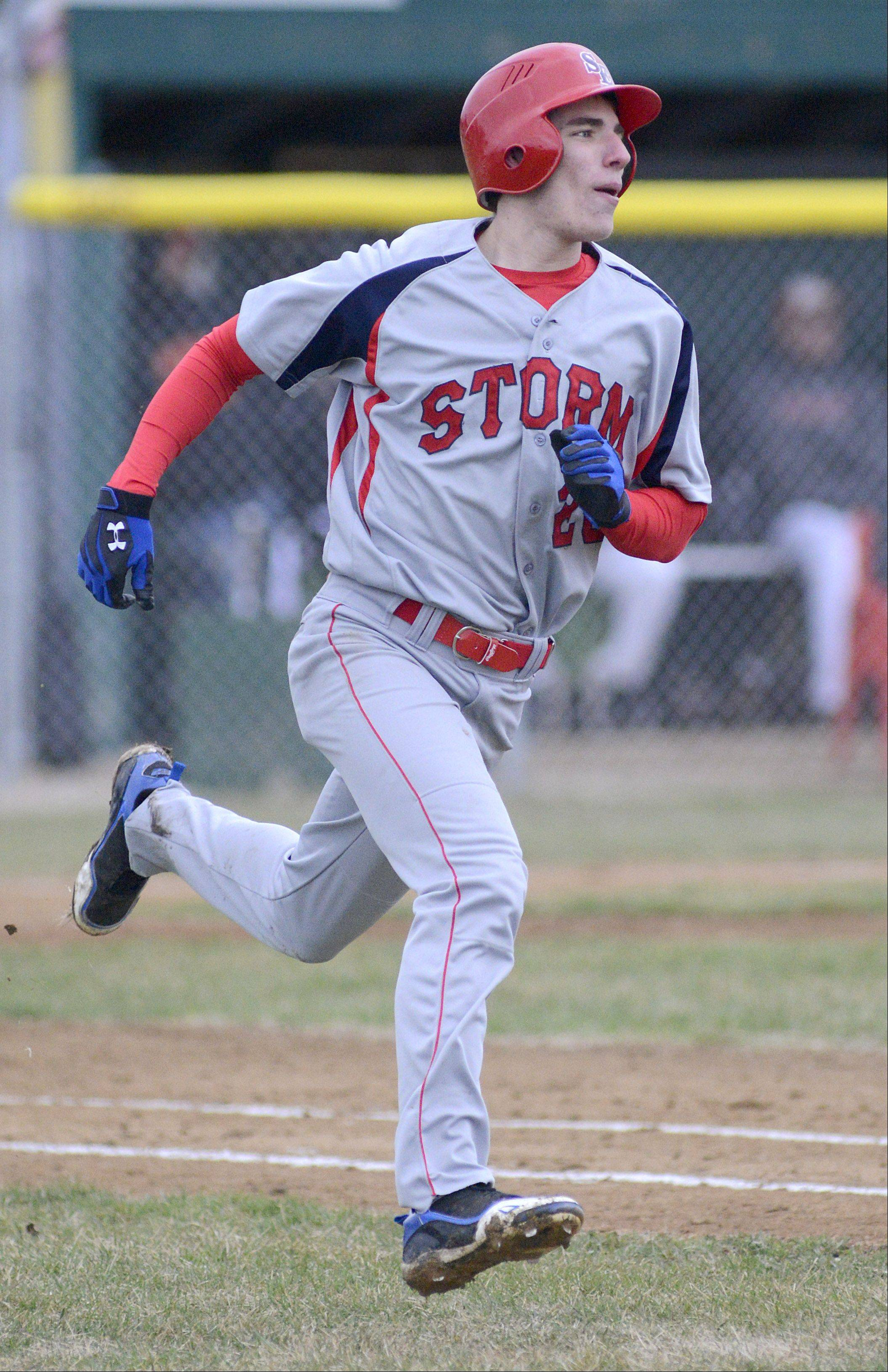 South Elgin's Ryan Nutof heads to first base after a hit that took him all the way around to third base in the fourth inning on Friday, April 12.