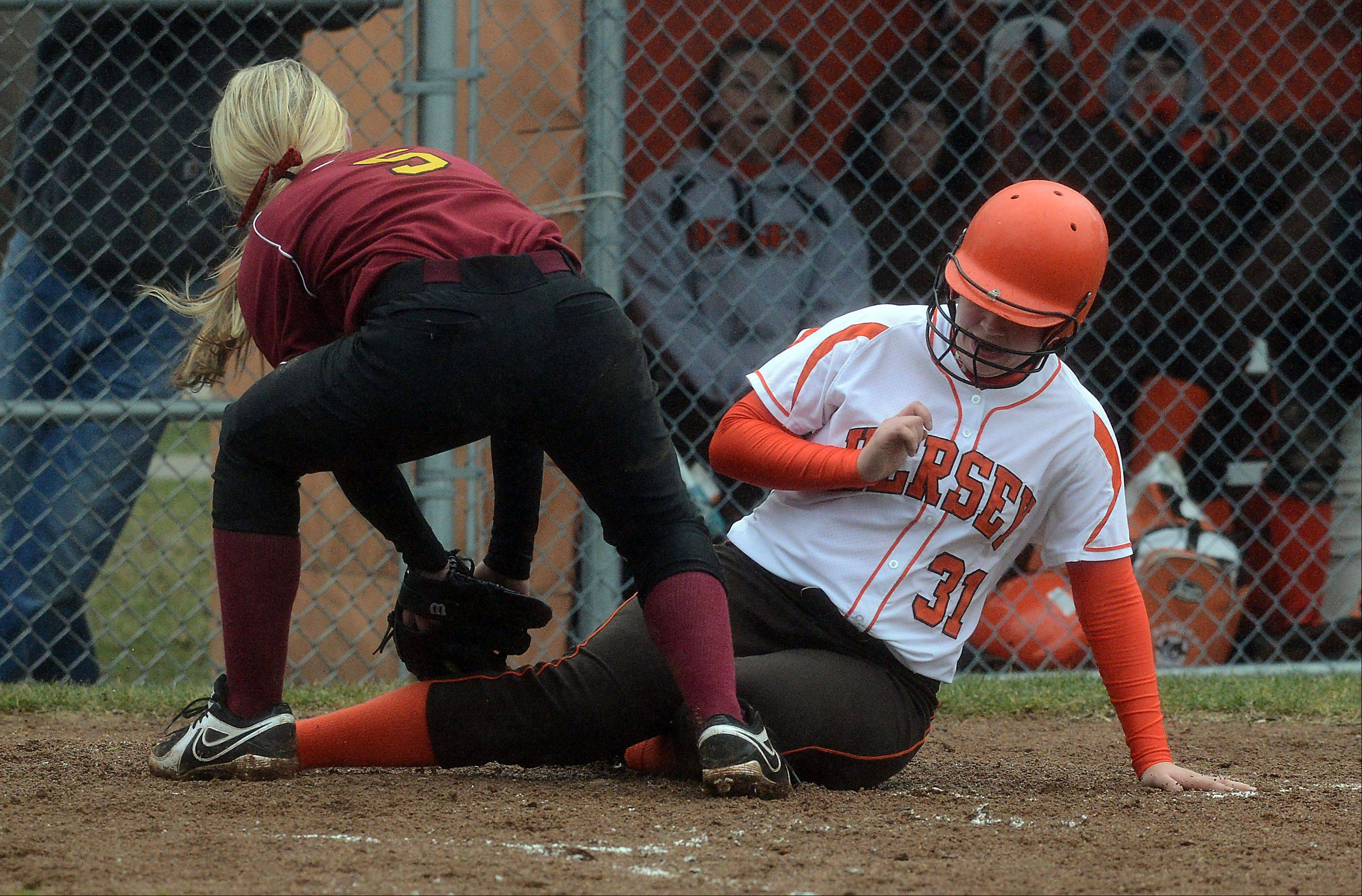 Schaumburg's Shannon Felde puts a late tag on Kelsey Panfil at the plate for Hersey's only run, which scored after a wild pitch in the third inning of a 13-1 Saxons victory at Hersey on Friday.
