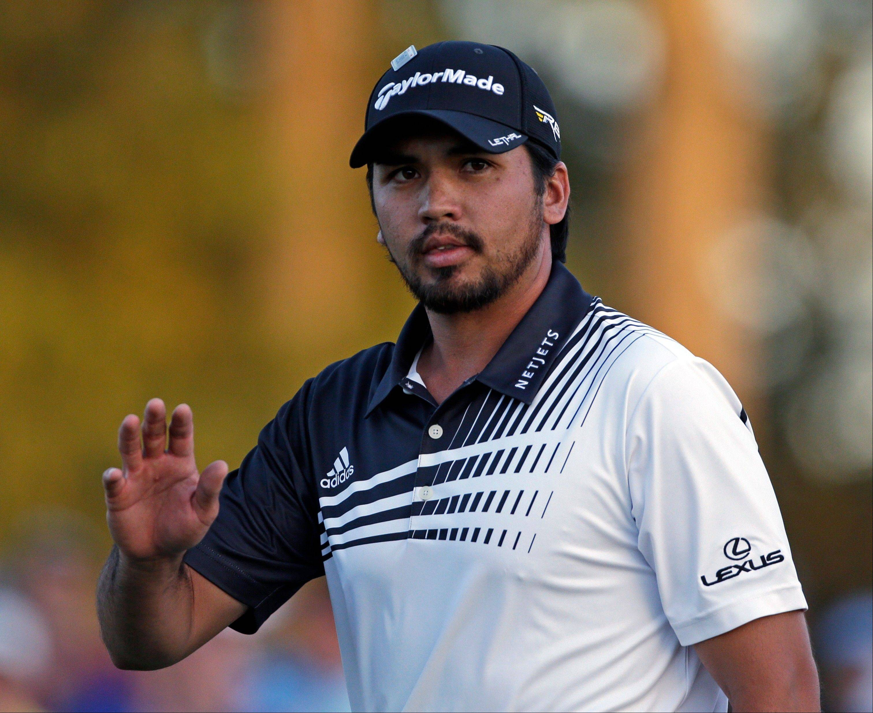 Jason Day, of Australia, waves to the gallery on the 18th hole during the second round of the Masters golf tournament Friday, April 12, 2013, in Augusta, Ga.