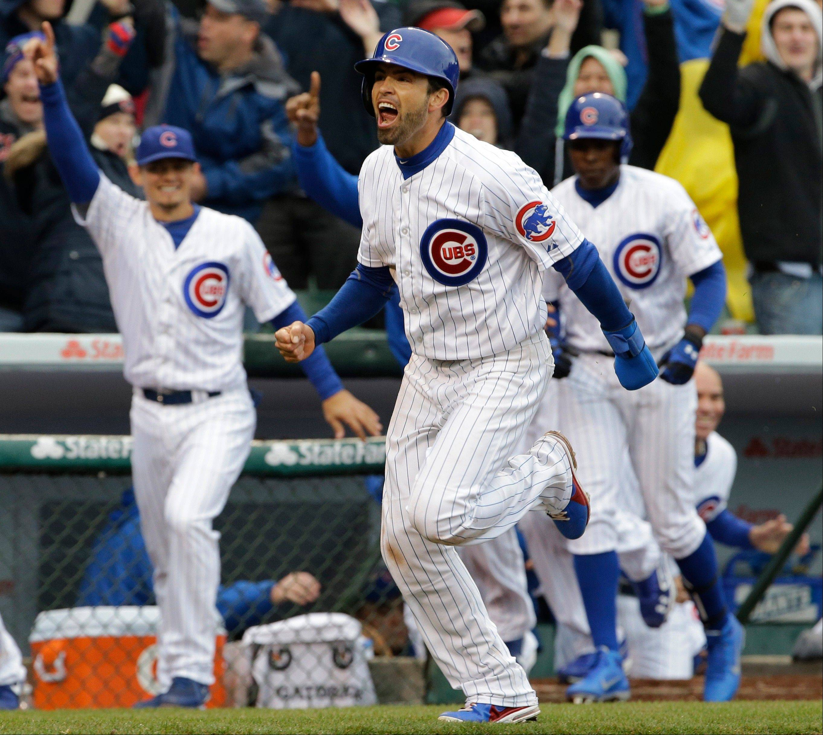 The Cubs' David DeJesus, foreground, celebrates as he runs to home after Starlin Castro hit the game-winning double against the Giants in the ninth inning Friday at Wrigley Field.