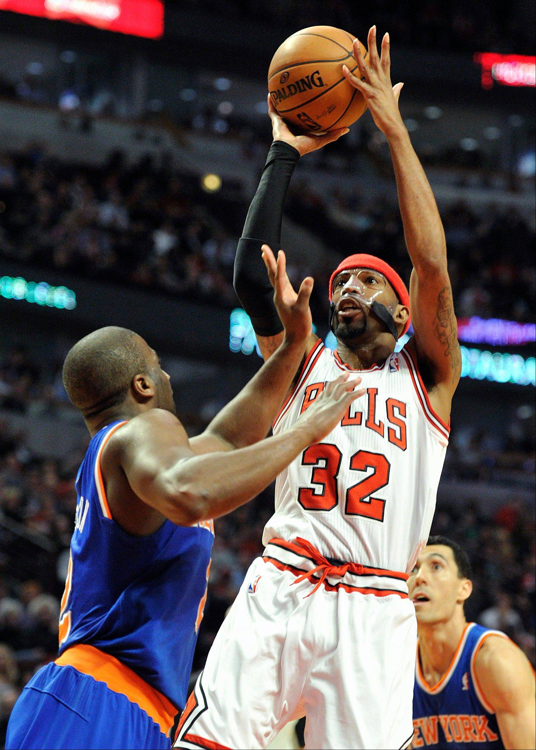 Chicago Bulls' Richard Hamilton (32) shoots over New York Knicks' Raymond Felton left, during the second half of an NBA basketball game, Thursday, April 11, 2013, in Chicago. The Bulls won 118-111 in overtime.