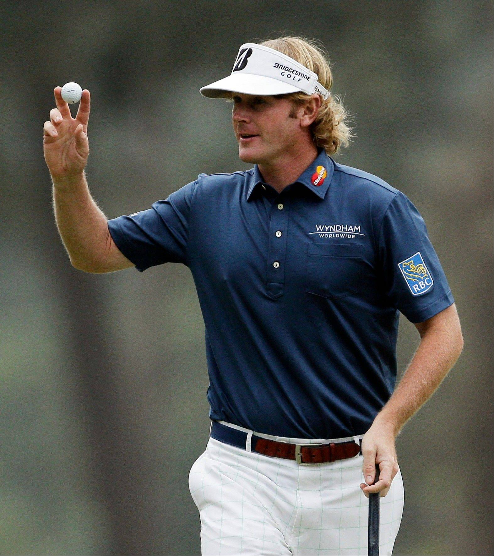 Brandt Snedeker, here celebrating a birdie putt on the third hole at The Masters on Thursday, finished the day with a 2-under 70.