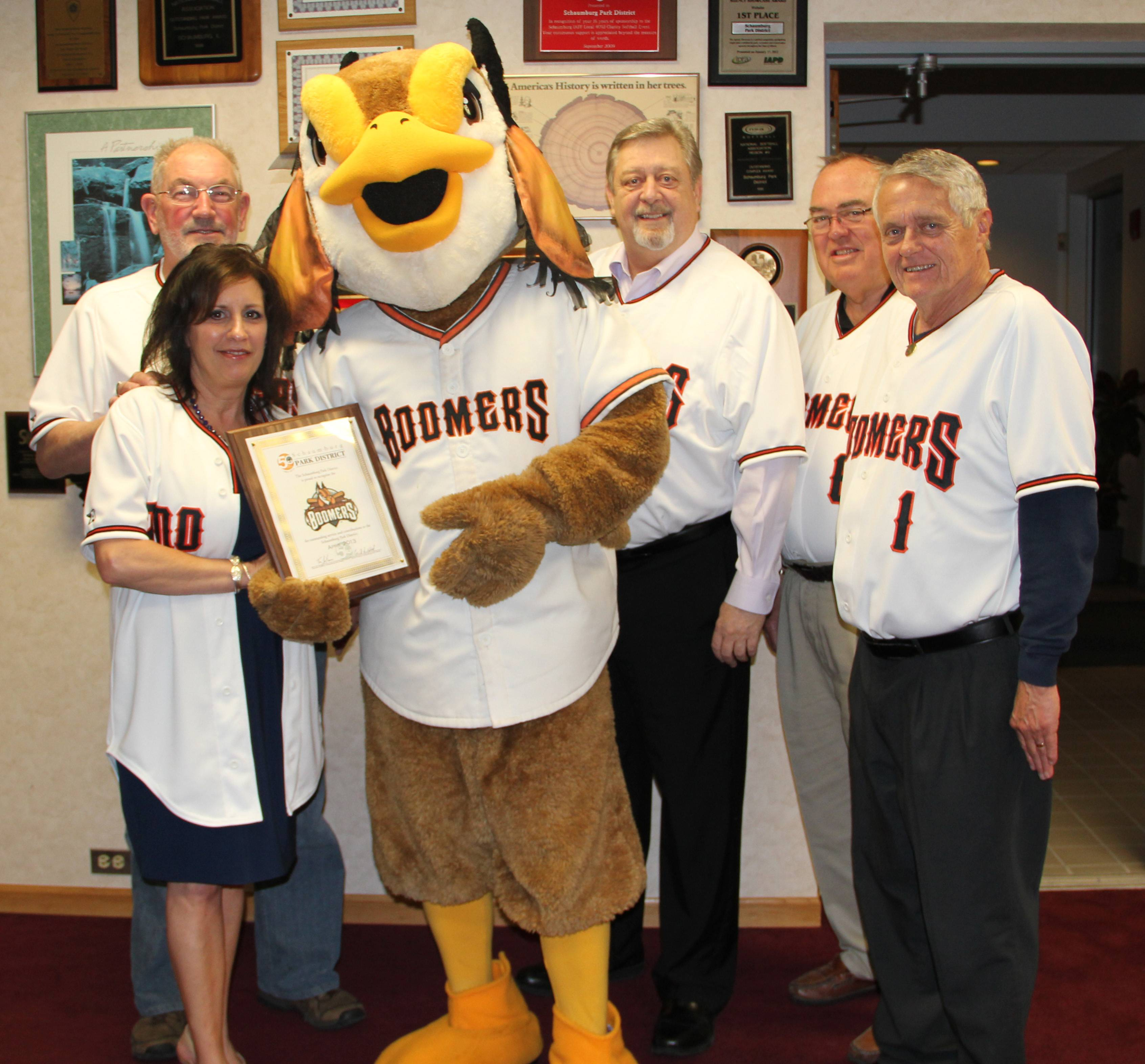 Celebrating the Schaumburg Boomers' partnership with the Schaumburg Park District are (l to r) Park Board President Bob Schmidt, Commissioner Sharon DiMaria, Coop the Boomers Mascot and Commissioners Mike Daniels, George Longmeyer and Dave Johnson.