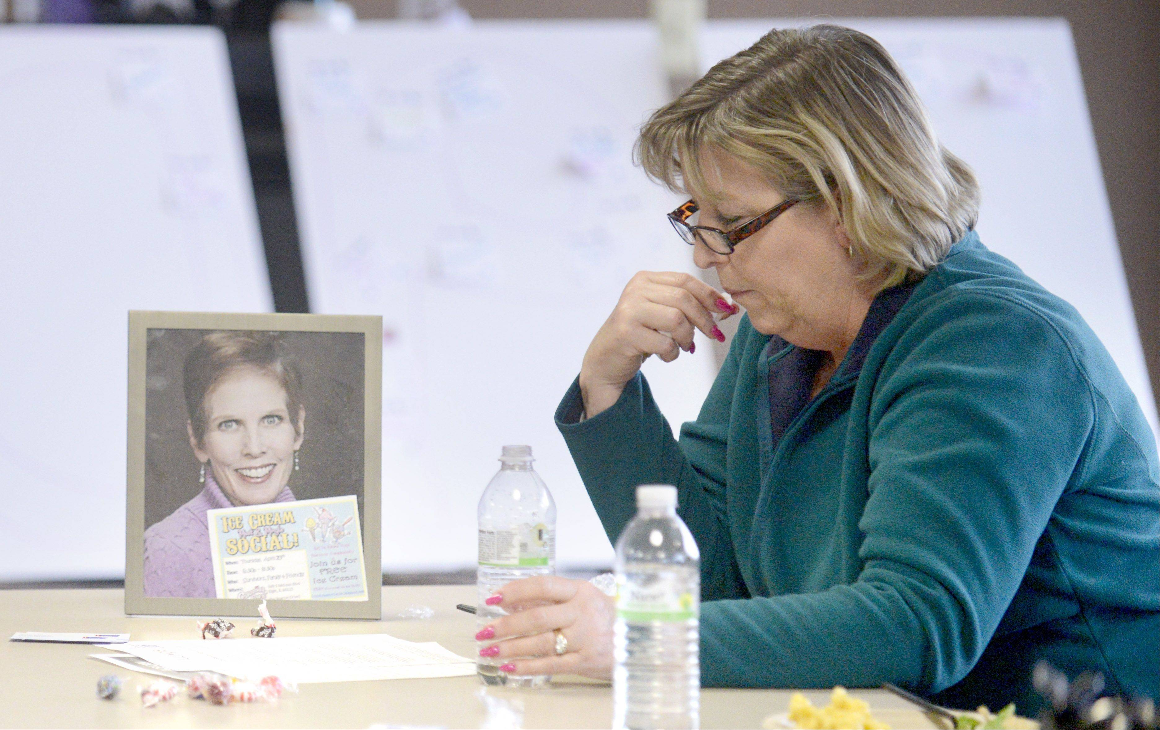 Debbie Weiman of Hampshire sits next to a portrait of her friend Margaret Hite of South Elgin during a kickoff event on Saturday for the American Cancer Society Relay For Life at Elgin Community College. The two are co-captains of a Relay For Life team they called �The Big Girl Panty Club.� Hite is a cancer patient. The relay event is June 14-15.