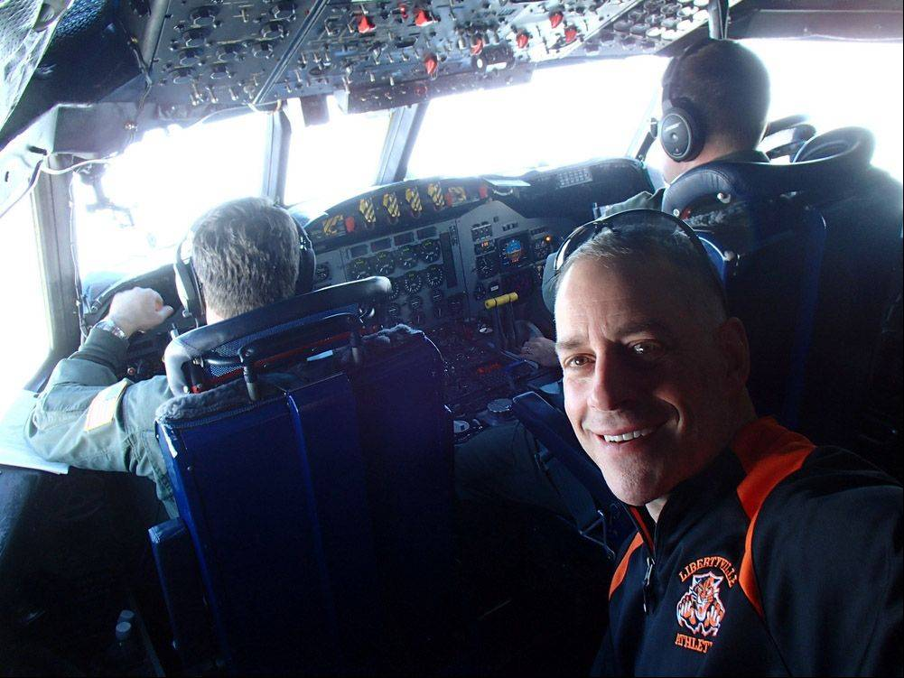 Libertyville High School teacher Mark Buesing is shown on a flight over Greenland. He�s there as part of a scientific expedition called Operation IceBridge.