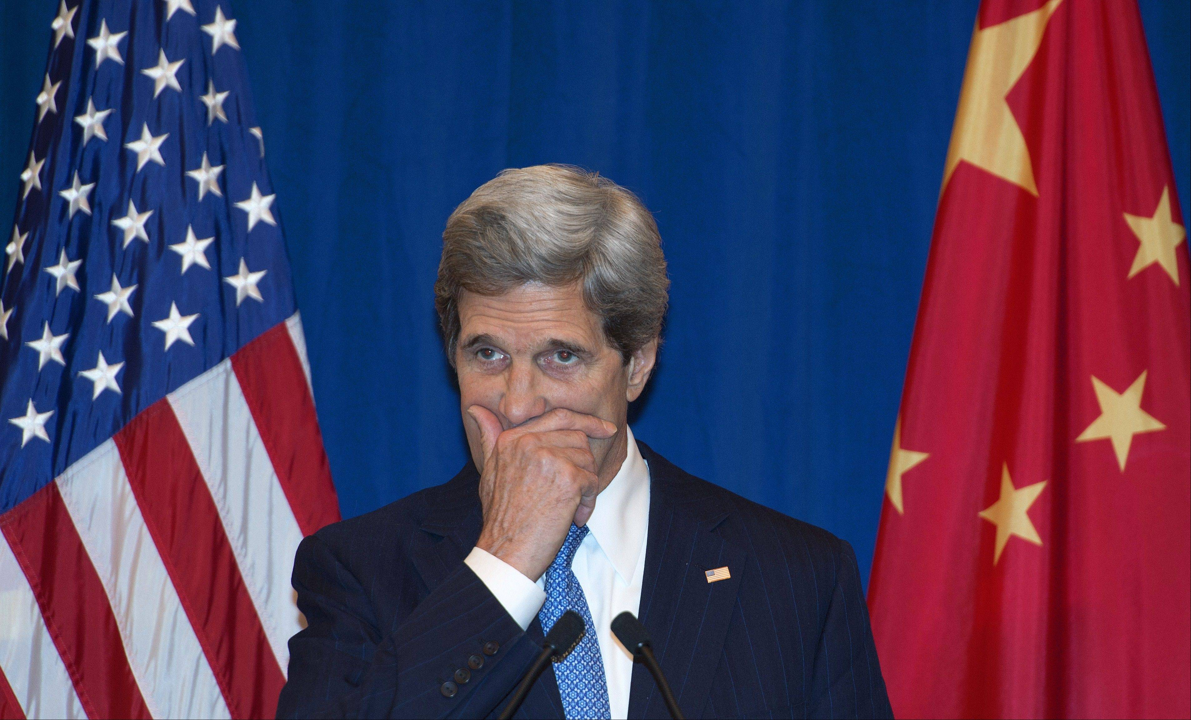 Secretary of State John Kerry conducts a press conference Saturday answering questions from U.S. and Chinese media, in Beijing, China.