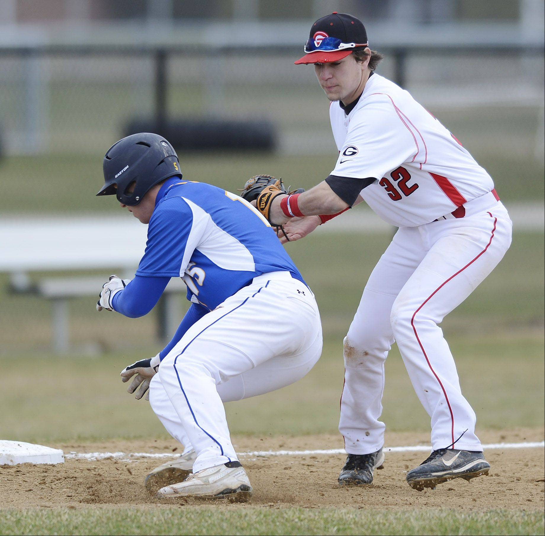 Warren�s Nick Orslini, left, gets tagged out at third by Grant�s Tyler Gorski while trying to stretch a double into a triple Saturday.
