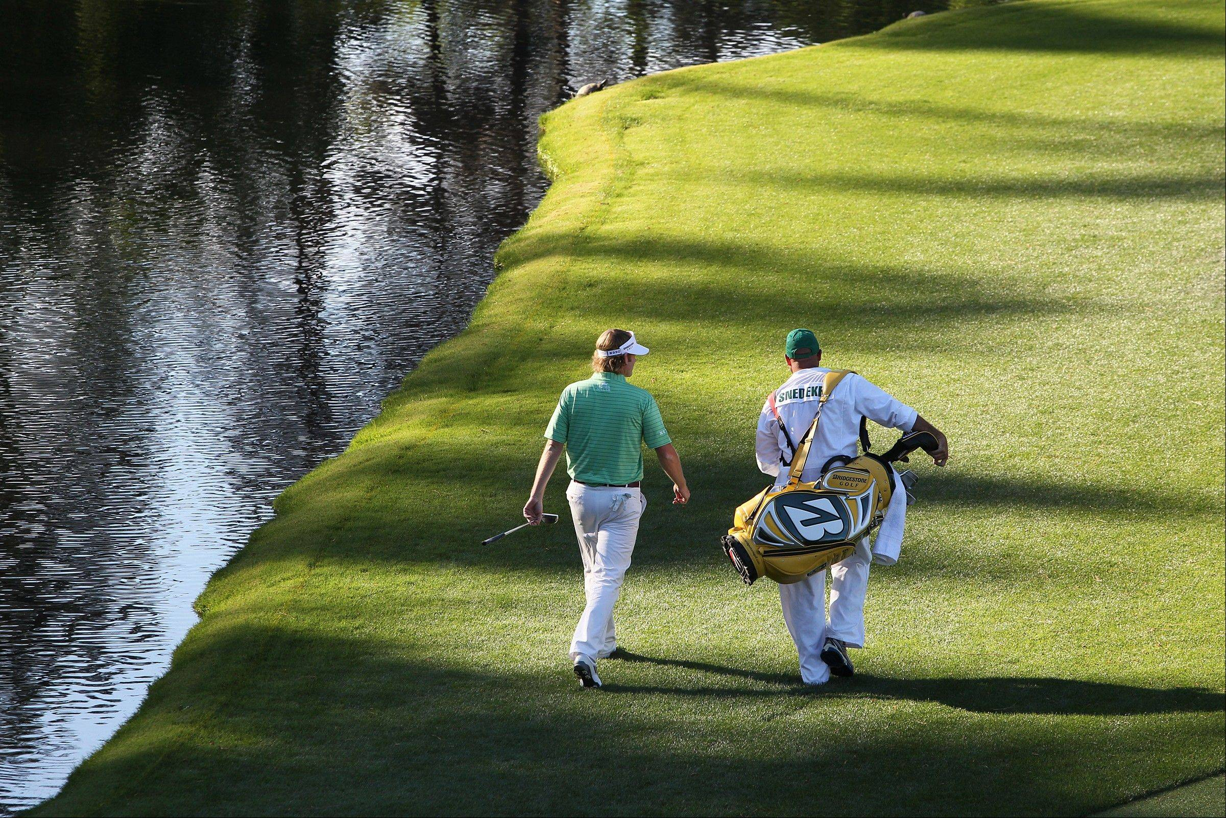 Brandt Snedeker strolls to the 16th green during the third round of the Masters golf tournament, on Saturday, April 13, 2013, in Augusta, Ga.