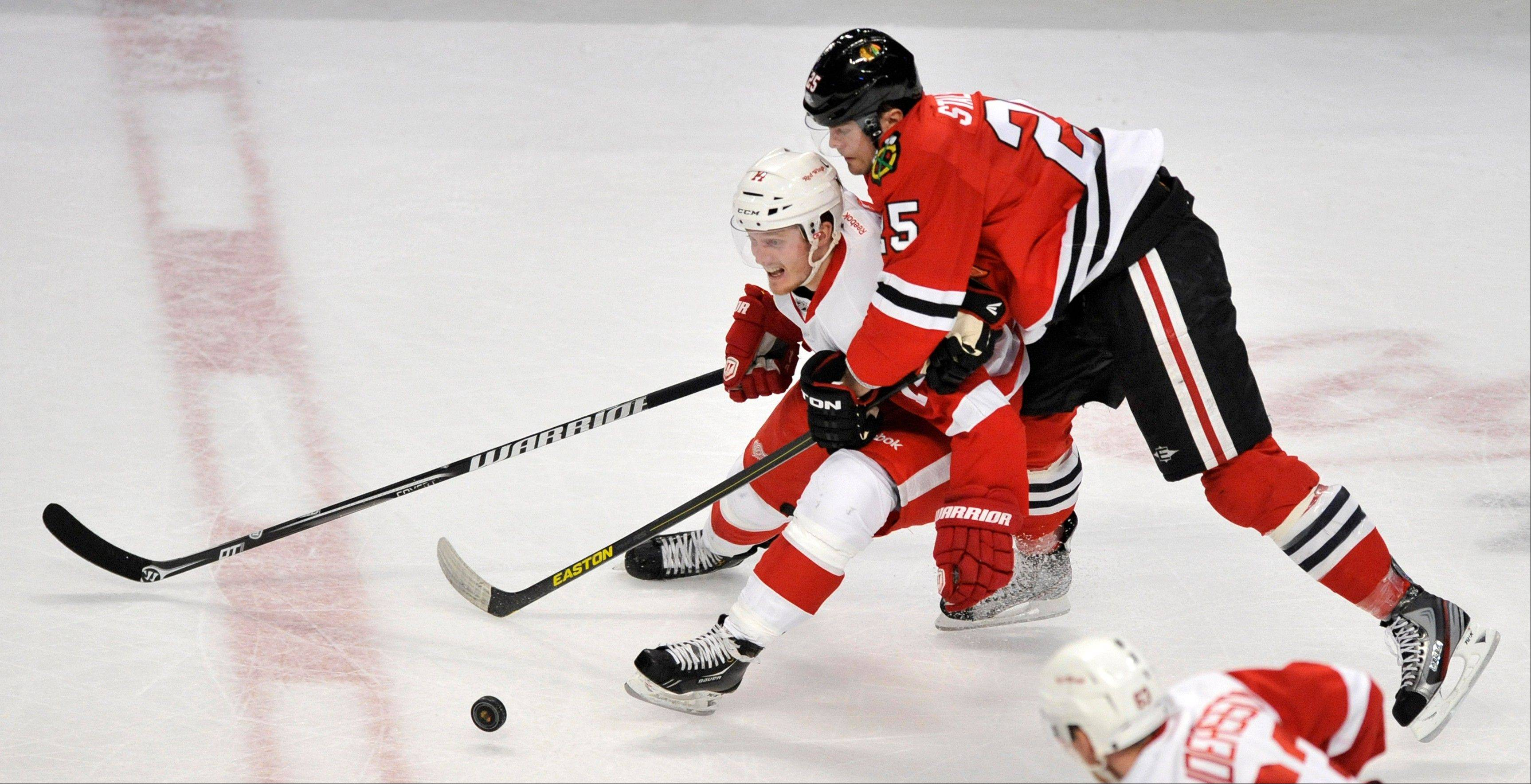 Viktor Stalberg (25), of Sweden, battles for the puck against Detroit Red Wings� Gustav Nyquist left, of Sweden during the second period of a NHL hockey game in Chicago, Friday, April 12, 2013. Chicago won 3-2 after a shootout.