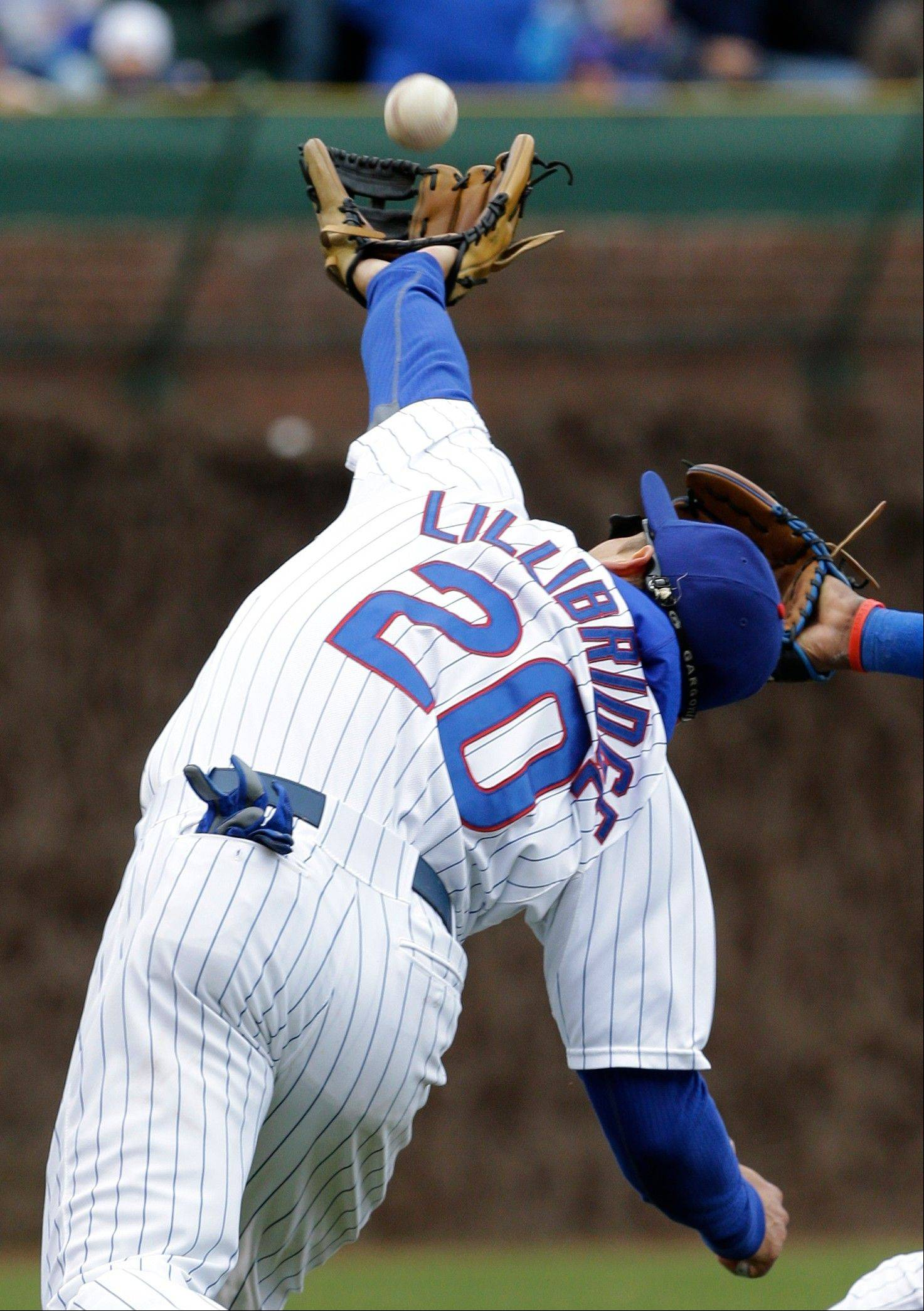 Cubs third baseman Brent Lillibridge nabs a popup hit by the Giants� Brandon Belt in the sixth inning Saturday at Wrigley Field.