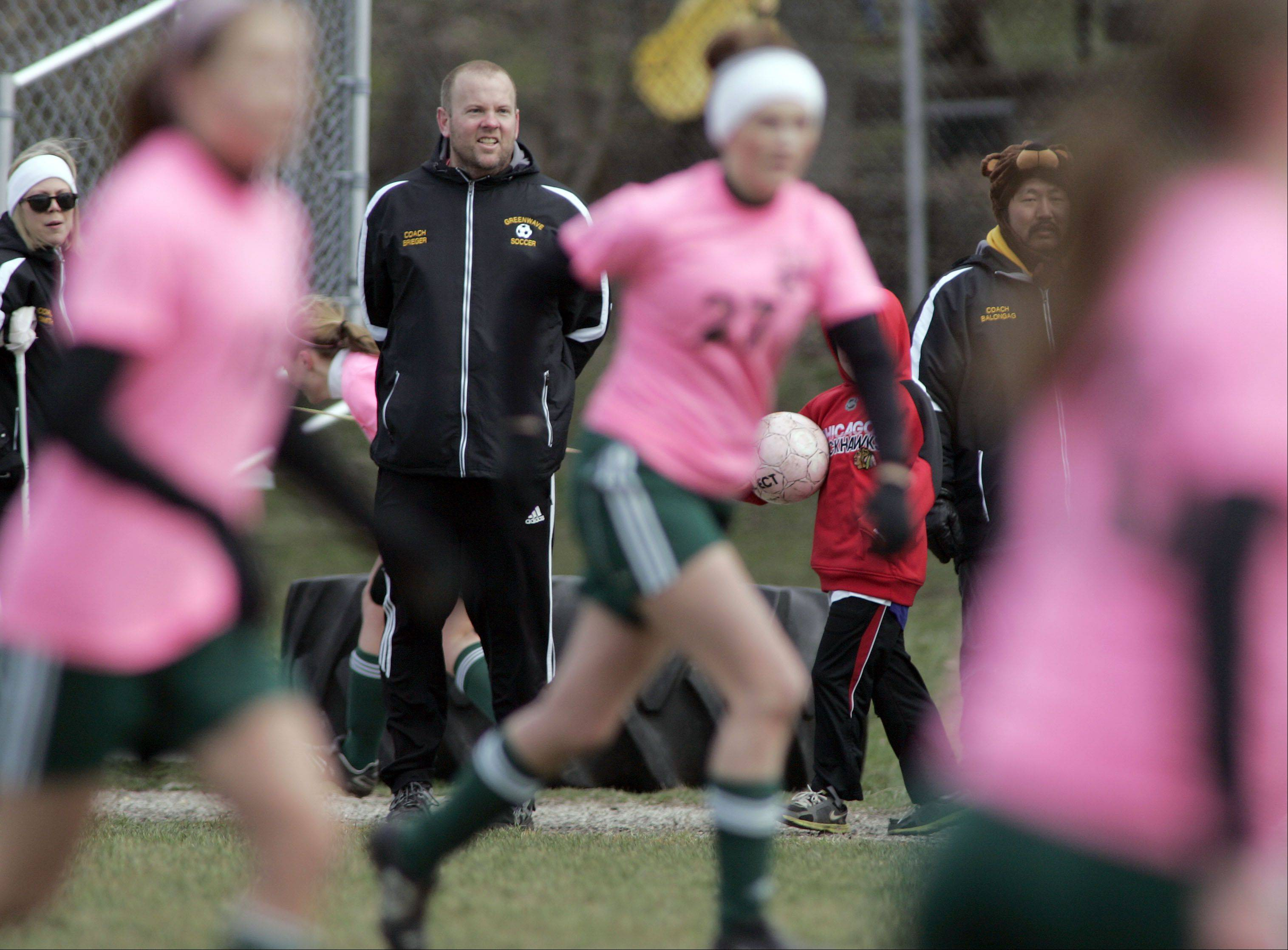 St. Edward girls soccer coach Tim Brieger, background, won his 200th game with the Green Wave girls program Saturday when his team beat Harvest Christian 3-0 at the Green Wave Invitational. Brieger started the girls program in 1996.
