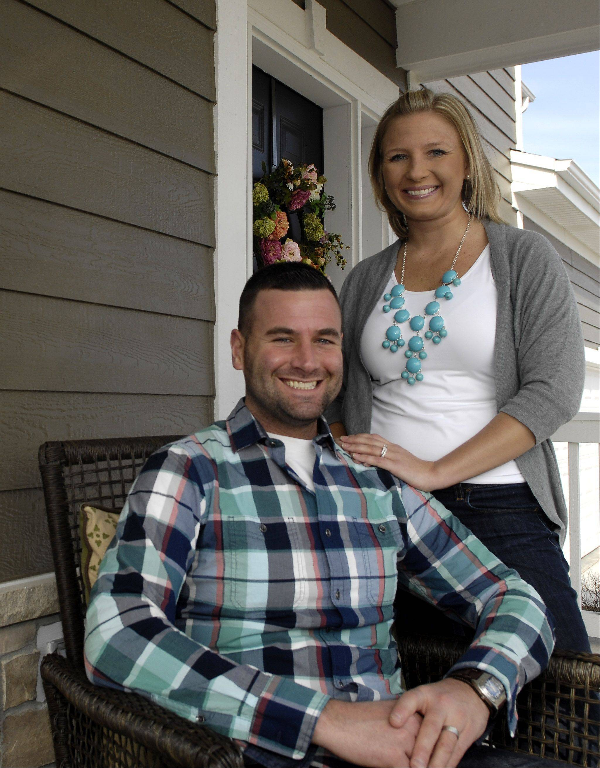 First-time homebuyers DJ and Michelle O'Brien are happy with their new home at Highland Woods in Elgin.