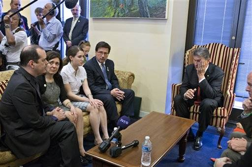 Sen. Joe Manchin, D-W.Va., seated right, meets in his office with families of victims of the Sandy Hook Elementary School shooting in Newtown, Conn., on the day he announced that they have reached reached a bipartisan deal on expanding background checks to more gun buyers, on Capitol Hill in Washington, Wednesday, April 10, 2013. Seated on sofa from left are David and Francine Wheeler, who lost their six-year-old son Ben in the shooting, Katy Sherlach and her father Bill Sherlach, whose wife Mary Sherlach was killed. At far right is Mark Barden, father of victim Daniel Barden.