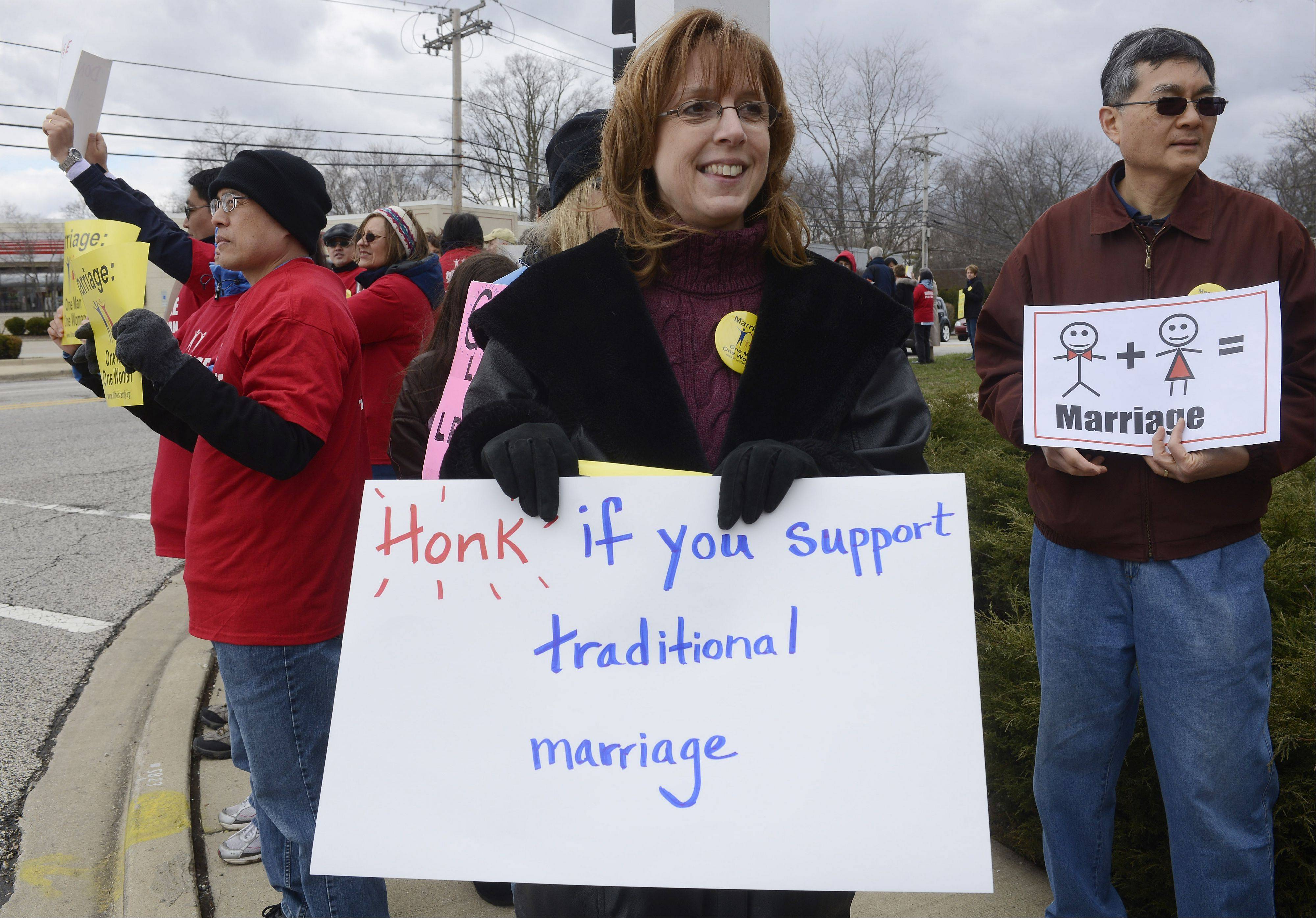 Activist Elise Bouc of Lake Zurich leads a protest opposing gay marriage Saturday outside state Rep. Ed Sullivan Jr.'s office in Mundelein.