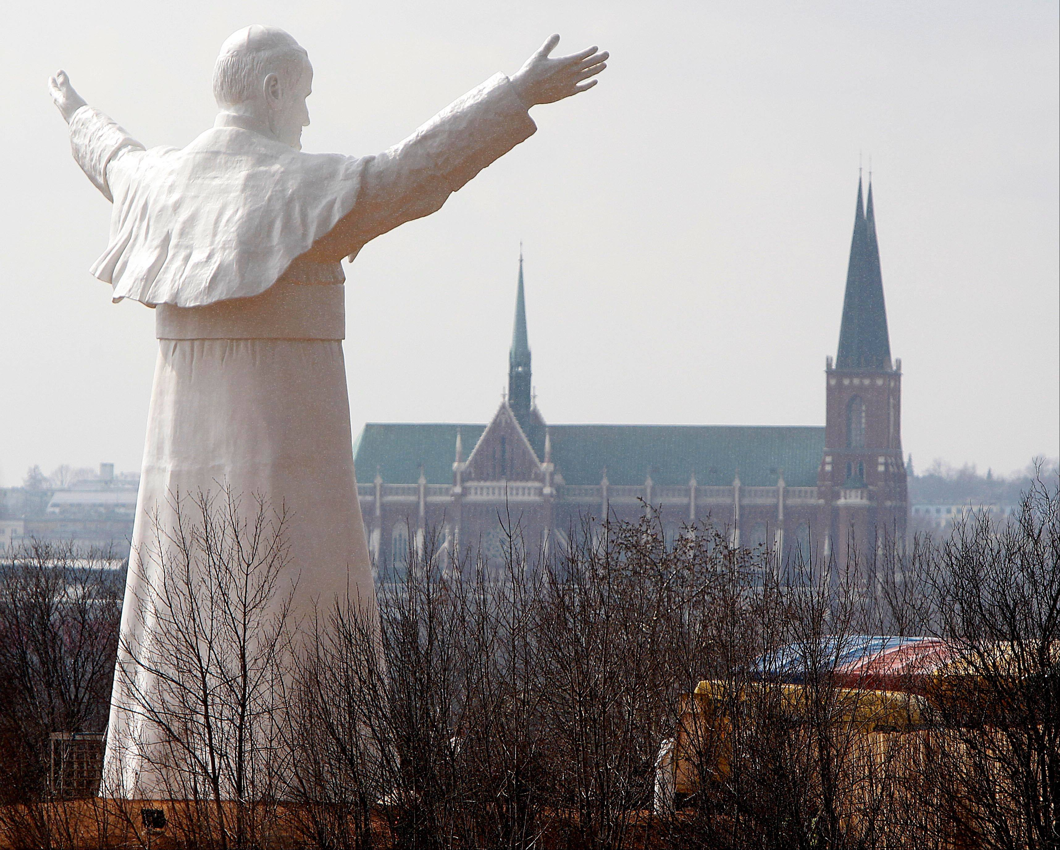 The sculpture of the late Pope John Paul II is unveiled Saturday during a ceremony in Czestochowa, Poland.