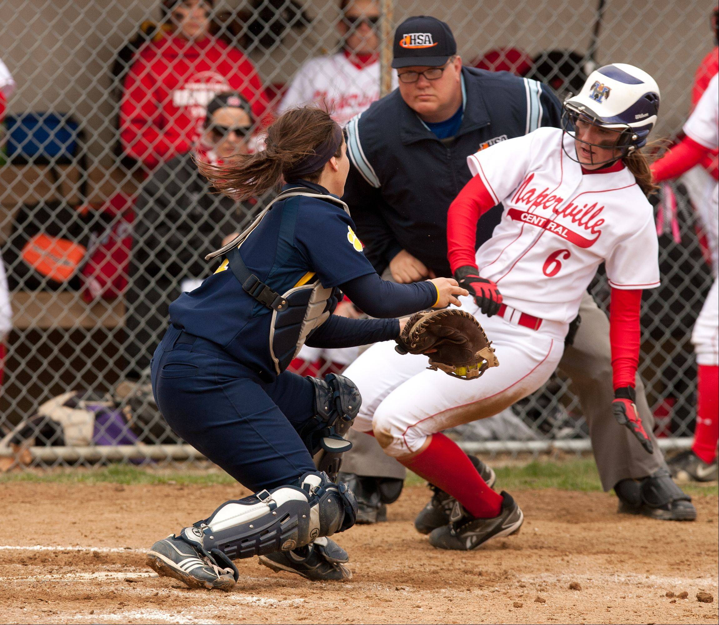 Neuqua Valley catcher Rebecca Lincoln tags out Naperville Central's Megan Nerger on Saturday at Naperville Central.