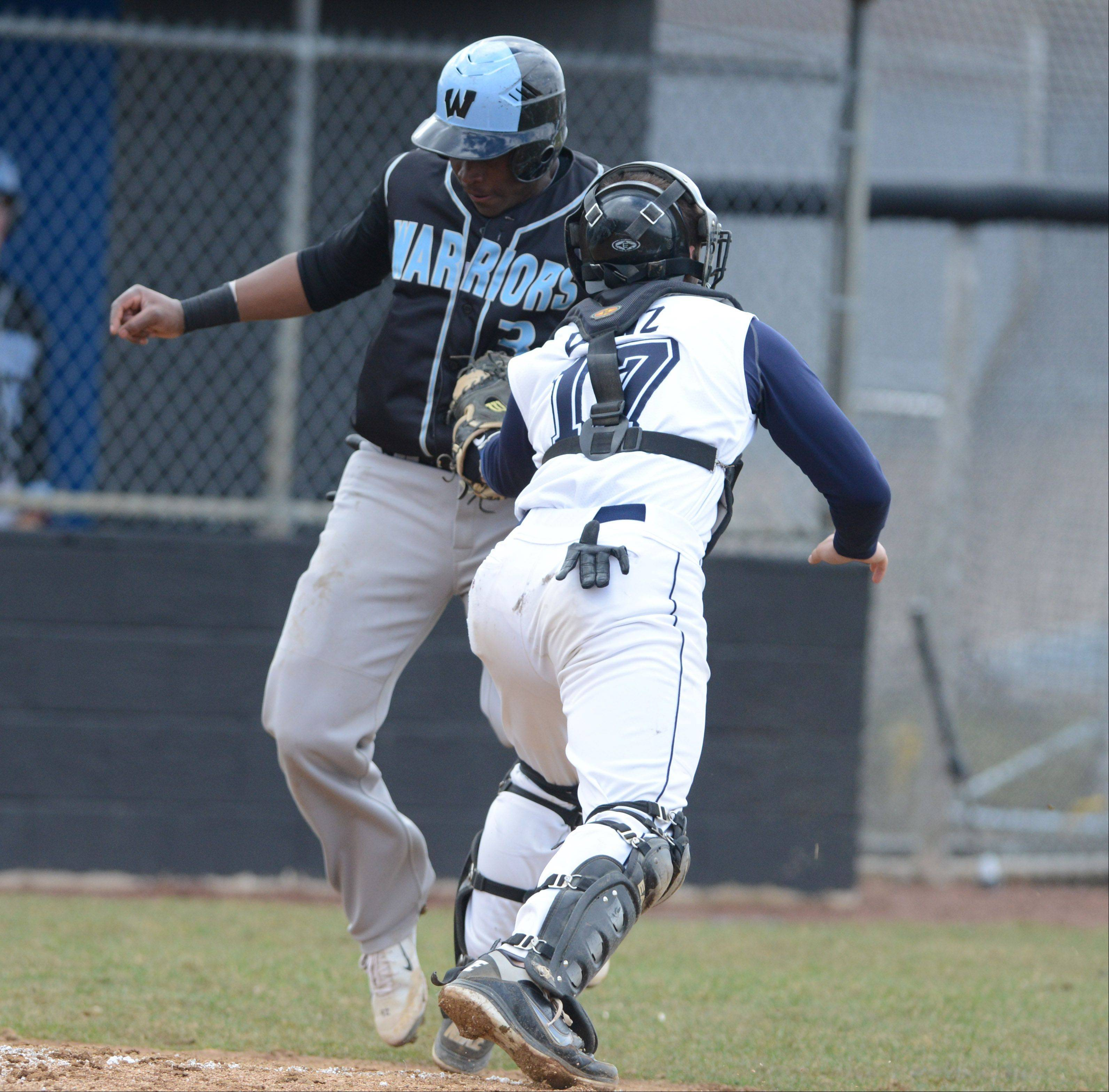 Gabe Gage of Willowbrook is tagged out by Zack Dowz of Addison Trail at home plate on Saturday in Addison.