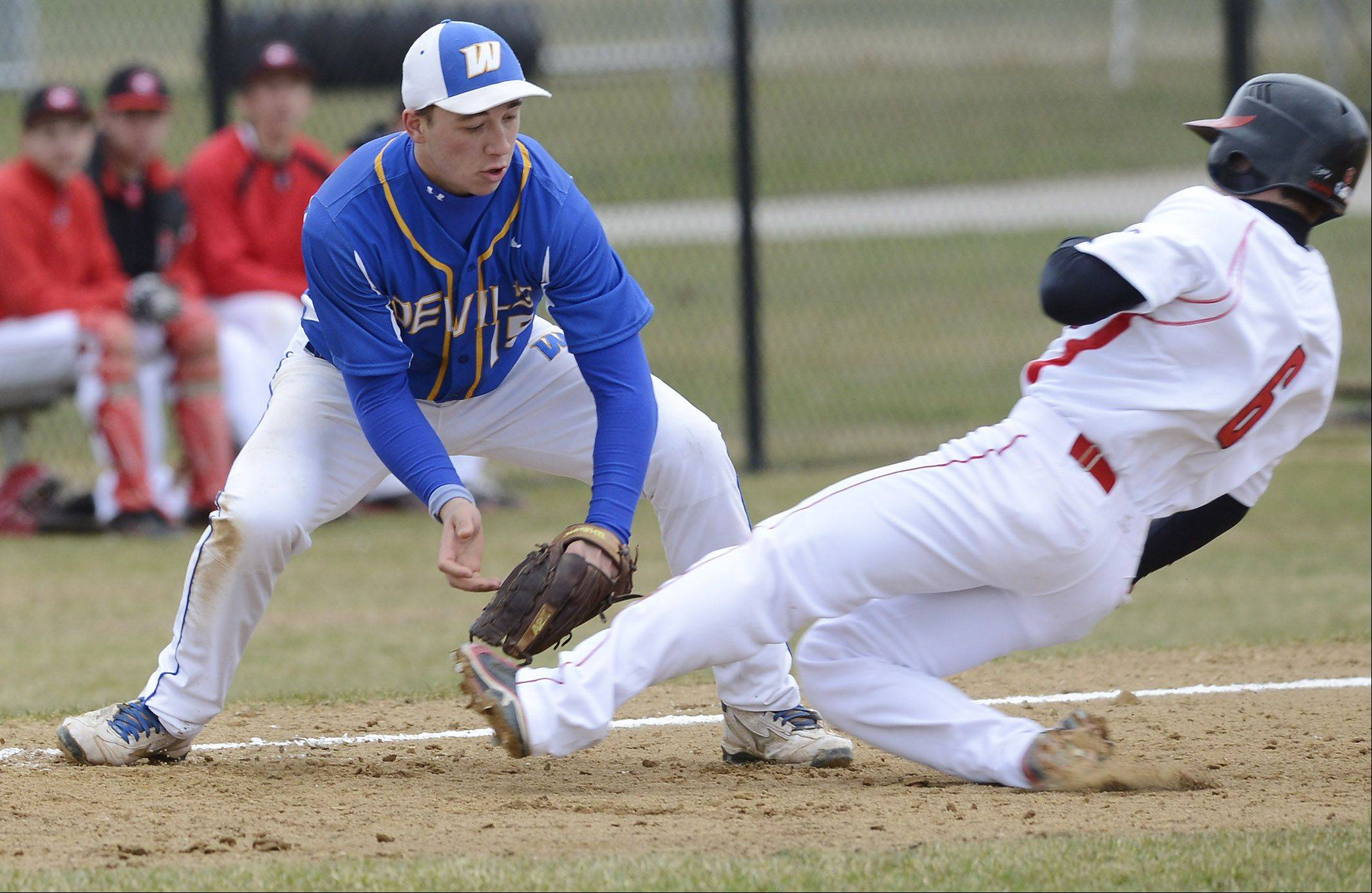 Warren third baseman Nick Orslini tags out Grant's Matt Paret on a fielder's choice during the fifth inning Saturday.