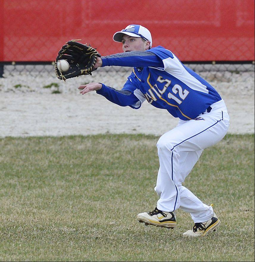 Warren's Kyle Kennedy catches a flyball in the outfield during Saturday's game at Grant.