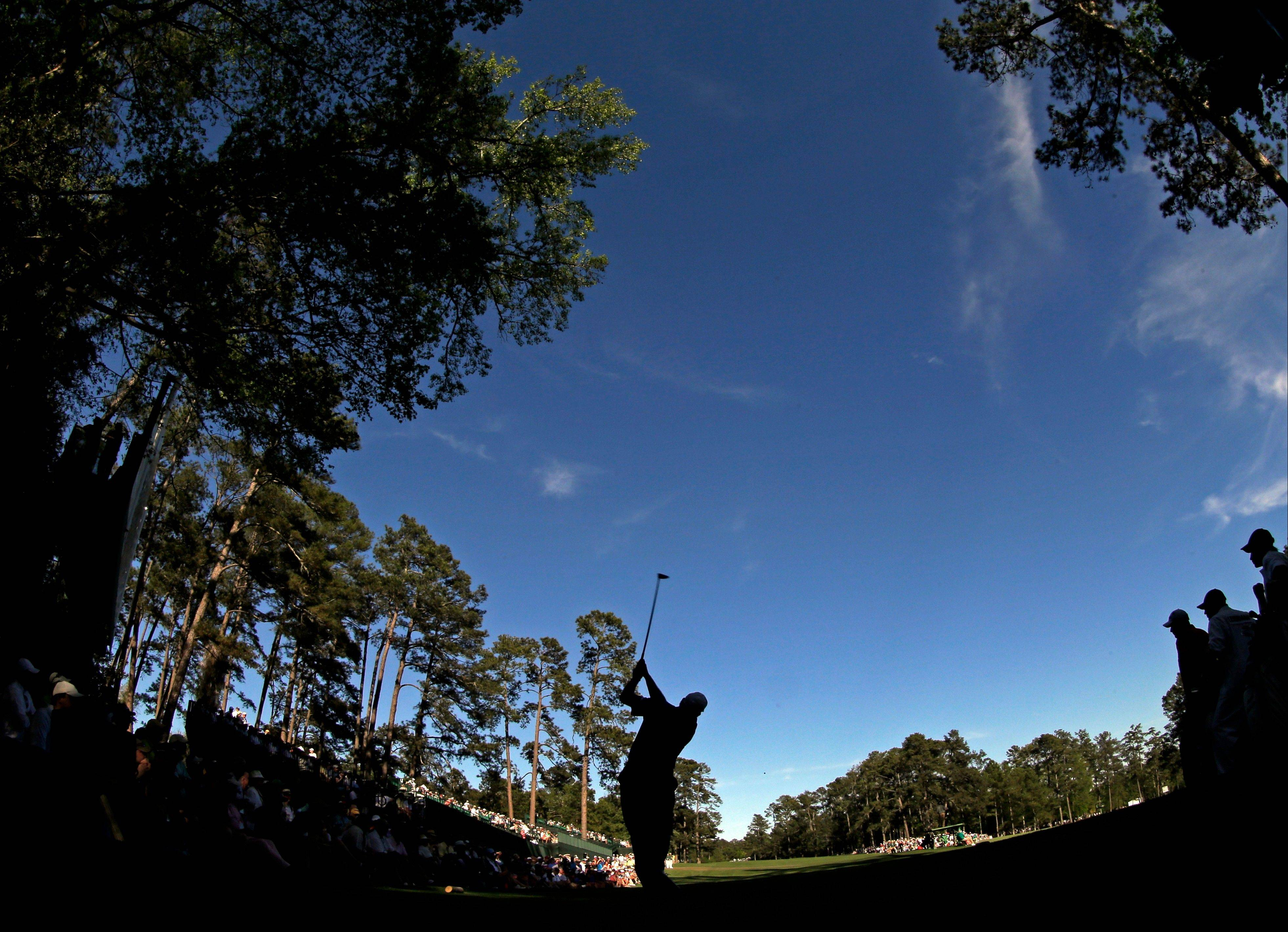 Angel Cabrera, of Argentina, tees off on the 14th hole during the third round of the Masters golf tournament Saturday, April 13, 2013, in Augusta, Ga.