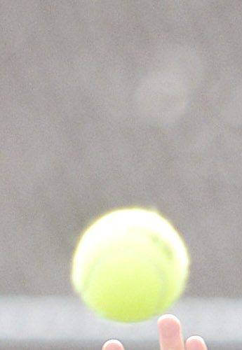 Geneva's Nick Huang returns a serve during a first doubles match against DeKalb on Saturday, April 13.