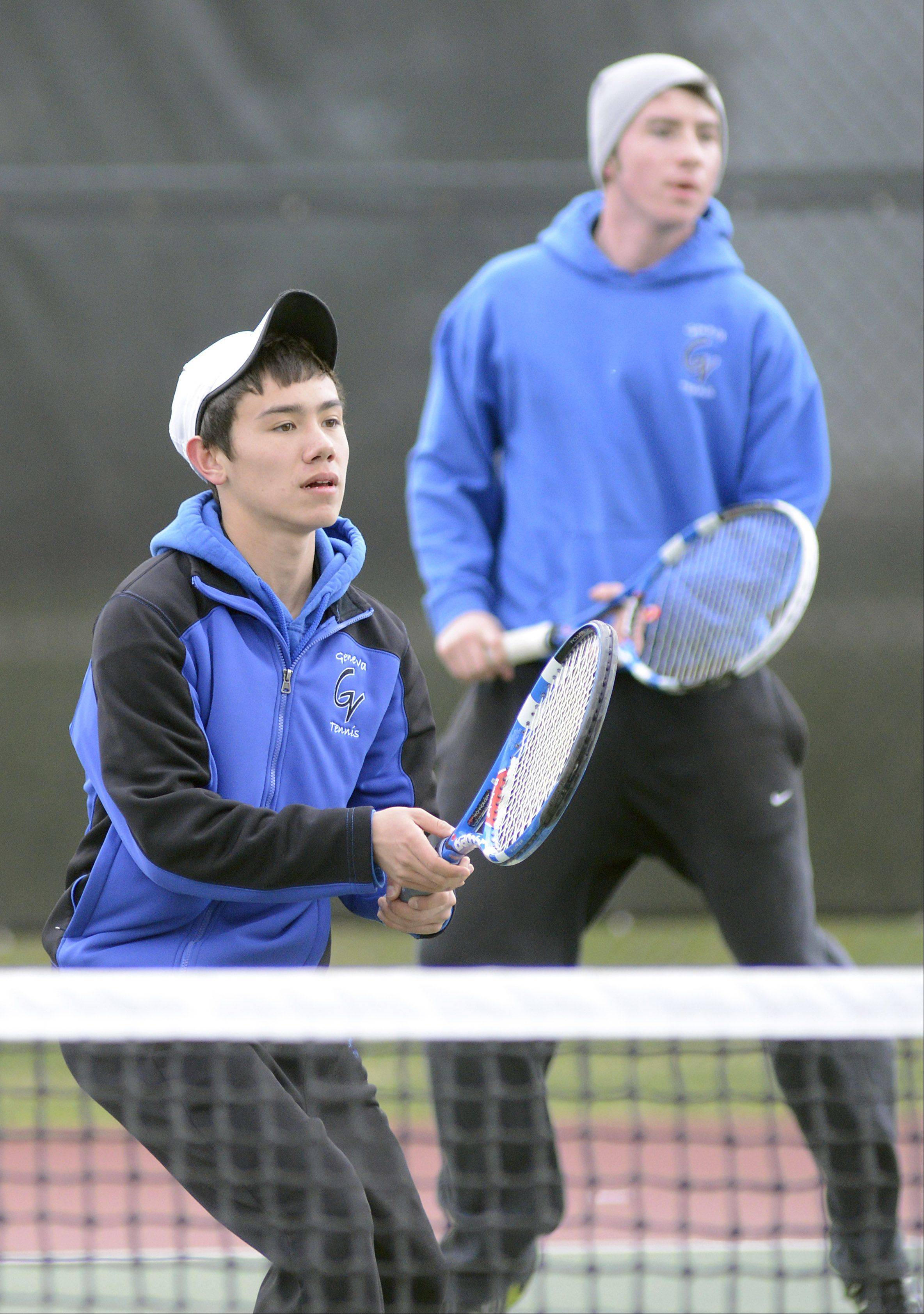 Geneva first doubles team, Nick Huang, left, and Ryan Doeckel wait for a serve from DeKalb on Saturday, April 13.