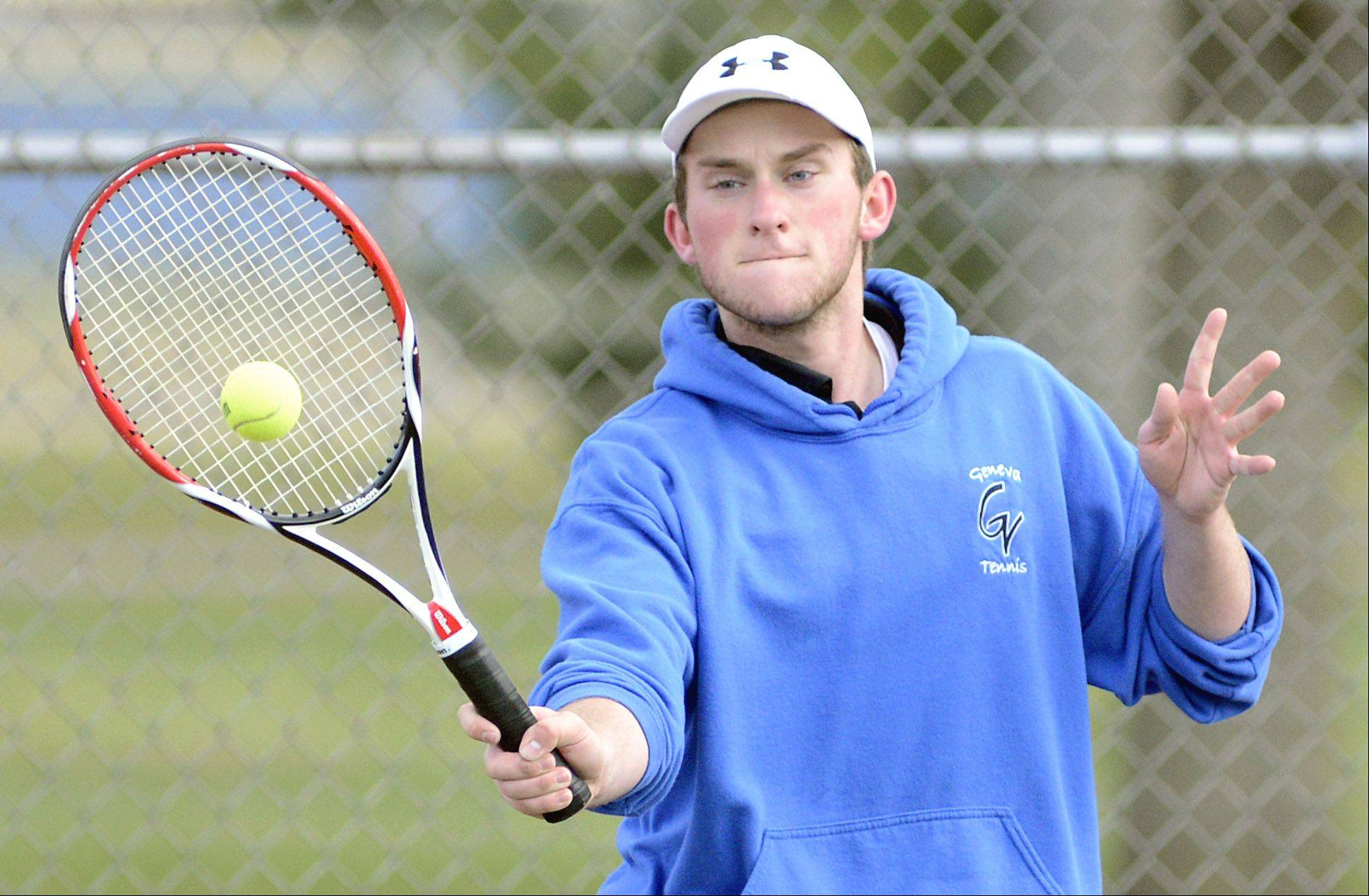 Geneva's Brad Burgess returns a serve from Marmion's Jackson Rettig in a first singles match on Saturday, April 13.