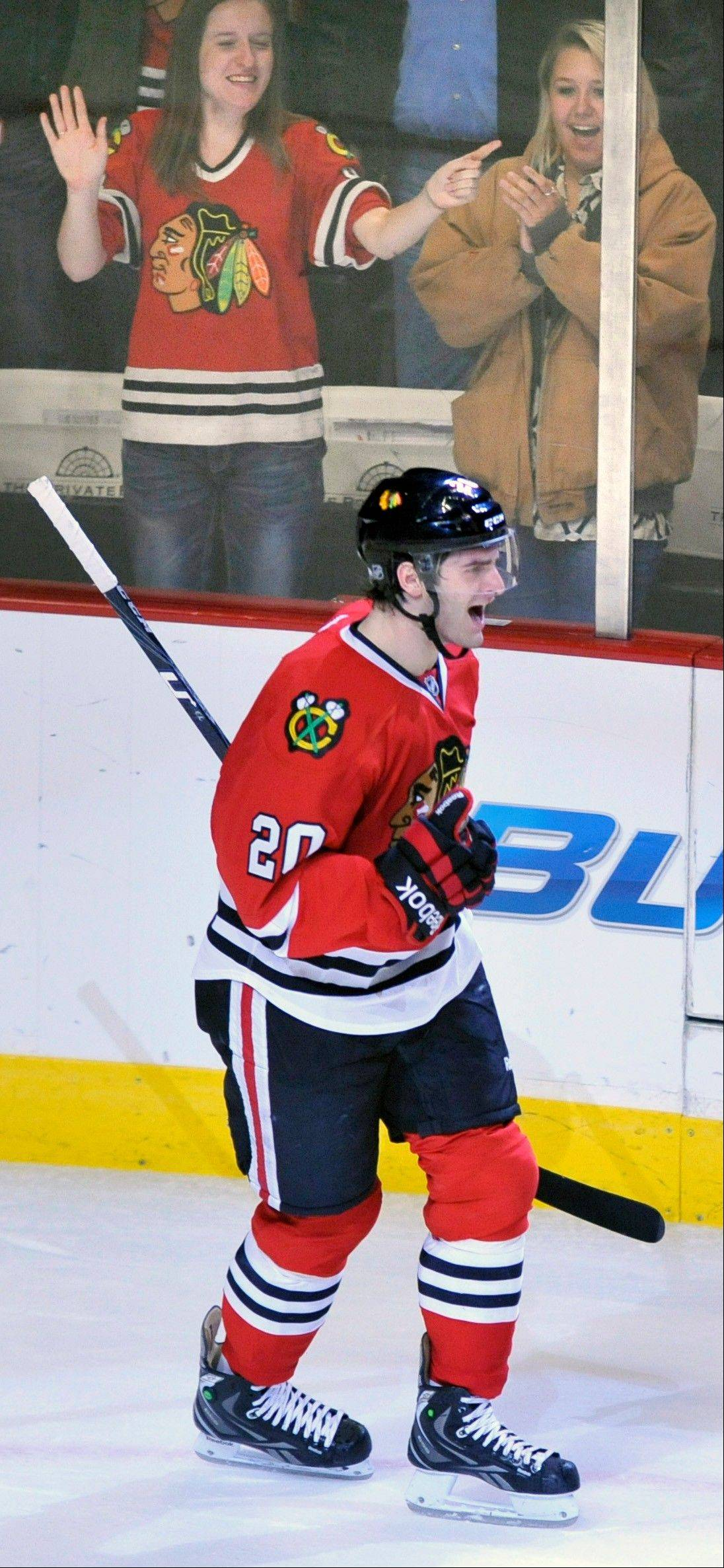 Brandon Saad celebrates after scoring the winning goal against the Detroit Red Wings during a shootout in an NHL hockey game in Chicago, Friday, April 12, 2013. Chicago won 3-2.