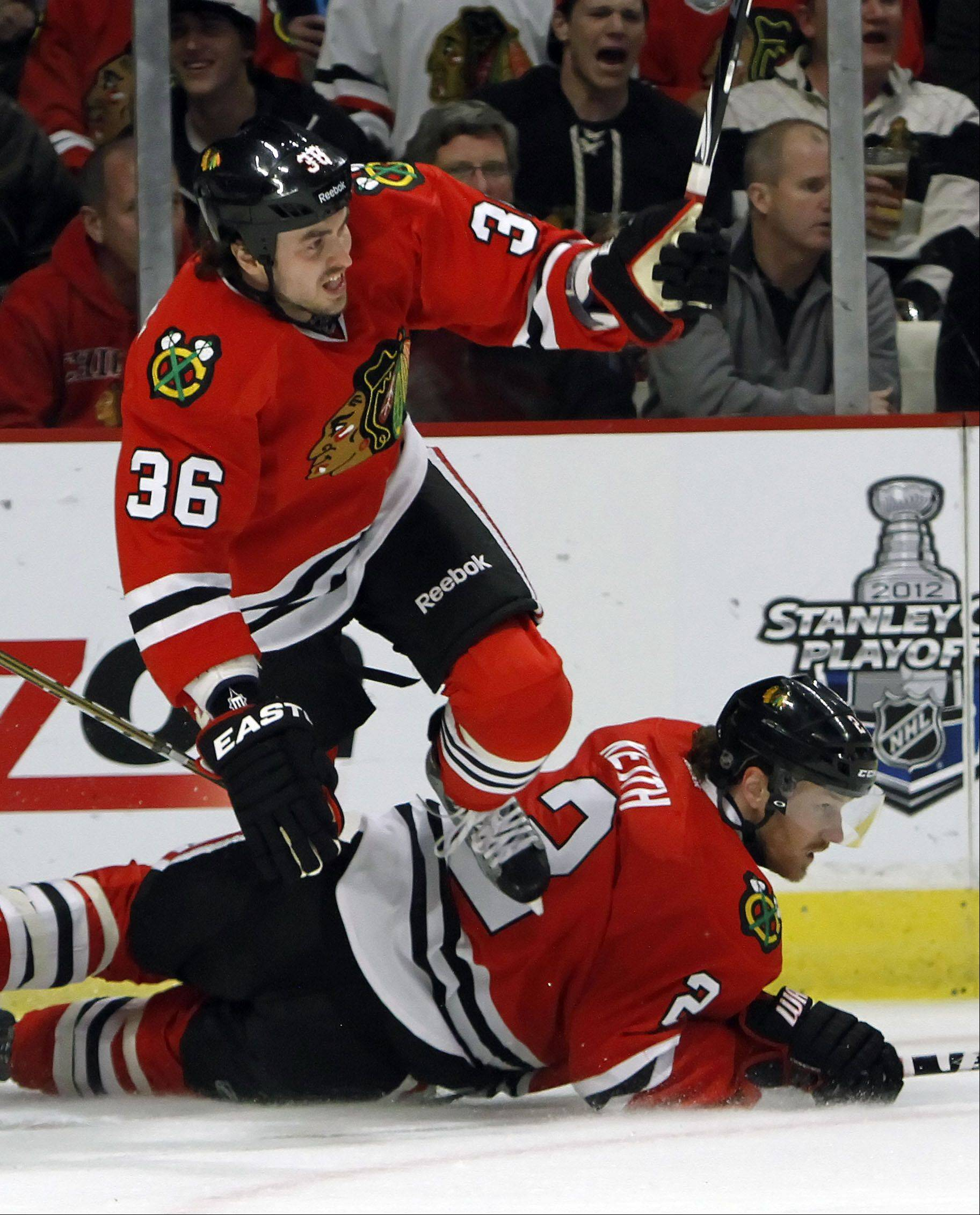 Dave Bolland, left, has missed the last four games with a foot injury but may return to the lineup today when the Hawks take on the Blues in St. Louis.