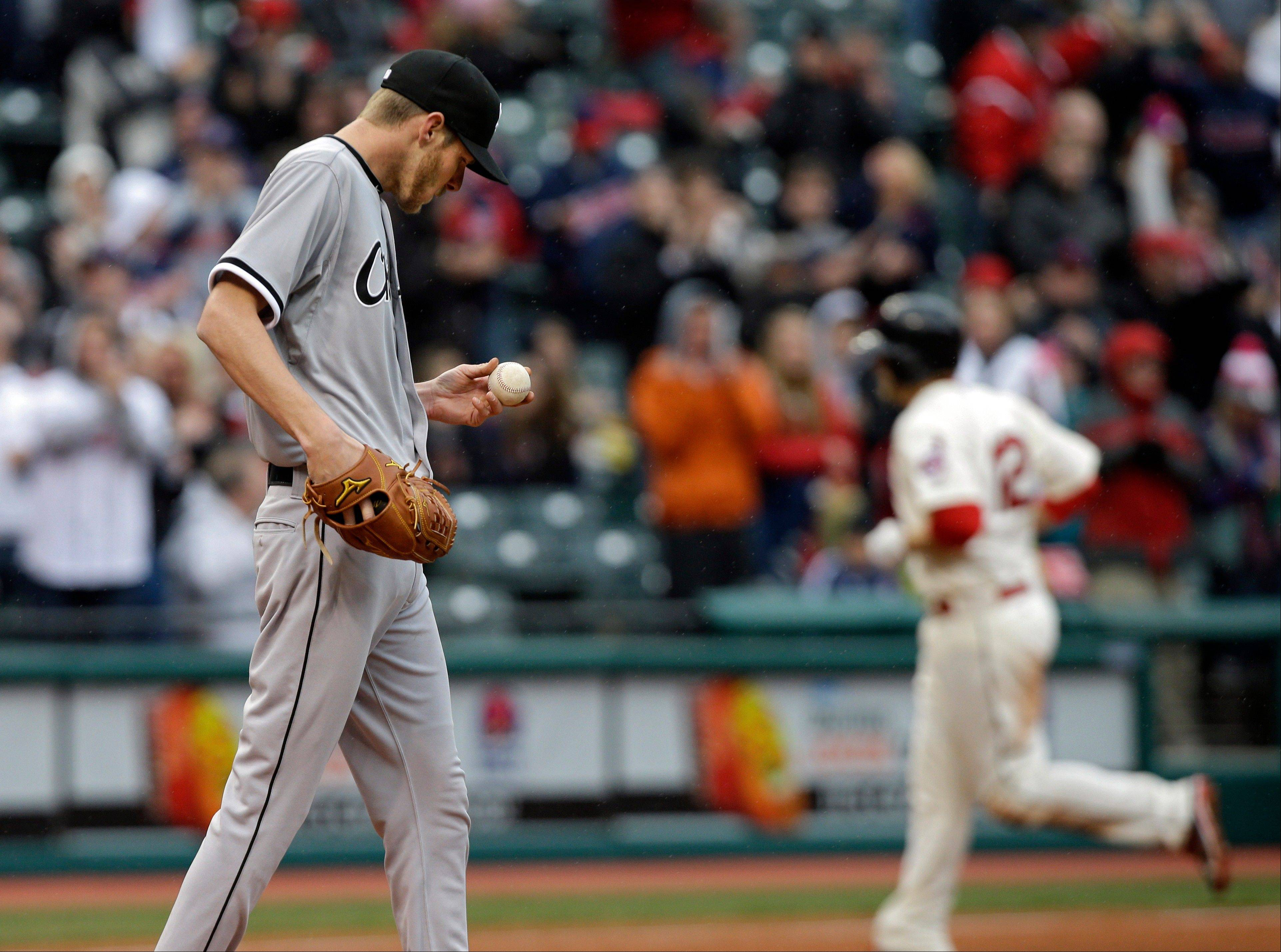 Chicago White Sox starting pitcher Chris Sale walks back to the mound after giving up a grand slam to Cleveland Indians' Mark Reynolds, background, in the fifth inning of a baseball game Saturday in Cleveland.