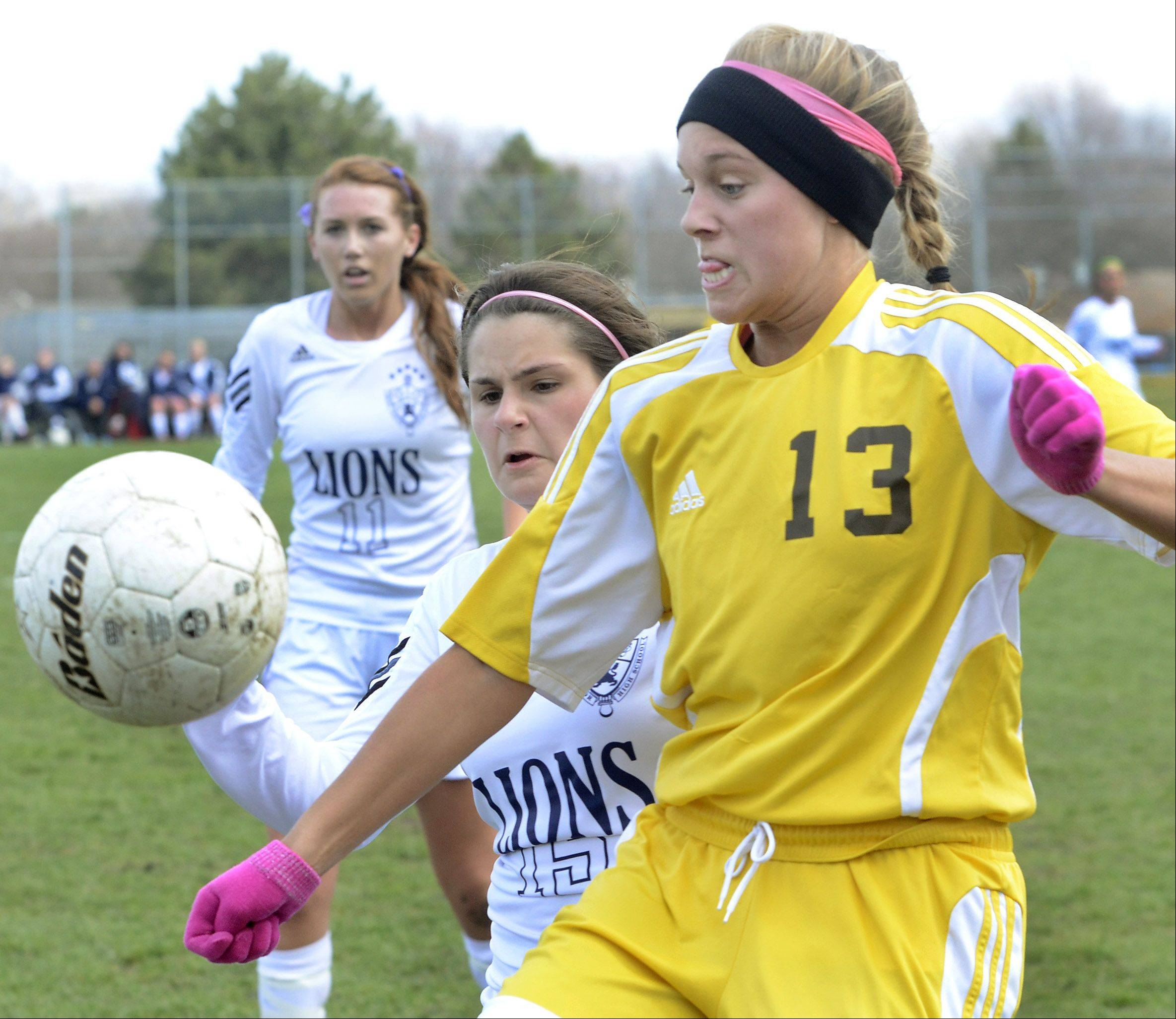 Carmel's Elizabeth Bream tries to keep the ball away from St. Viator's Emily Zahrebelski on Saturday in Arlington Heights.