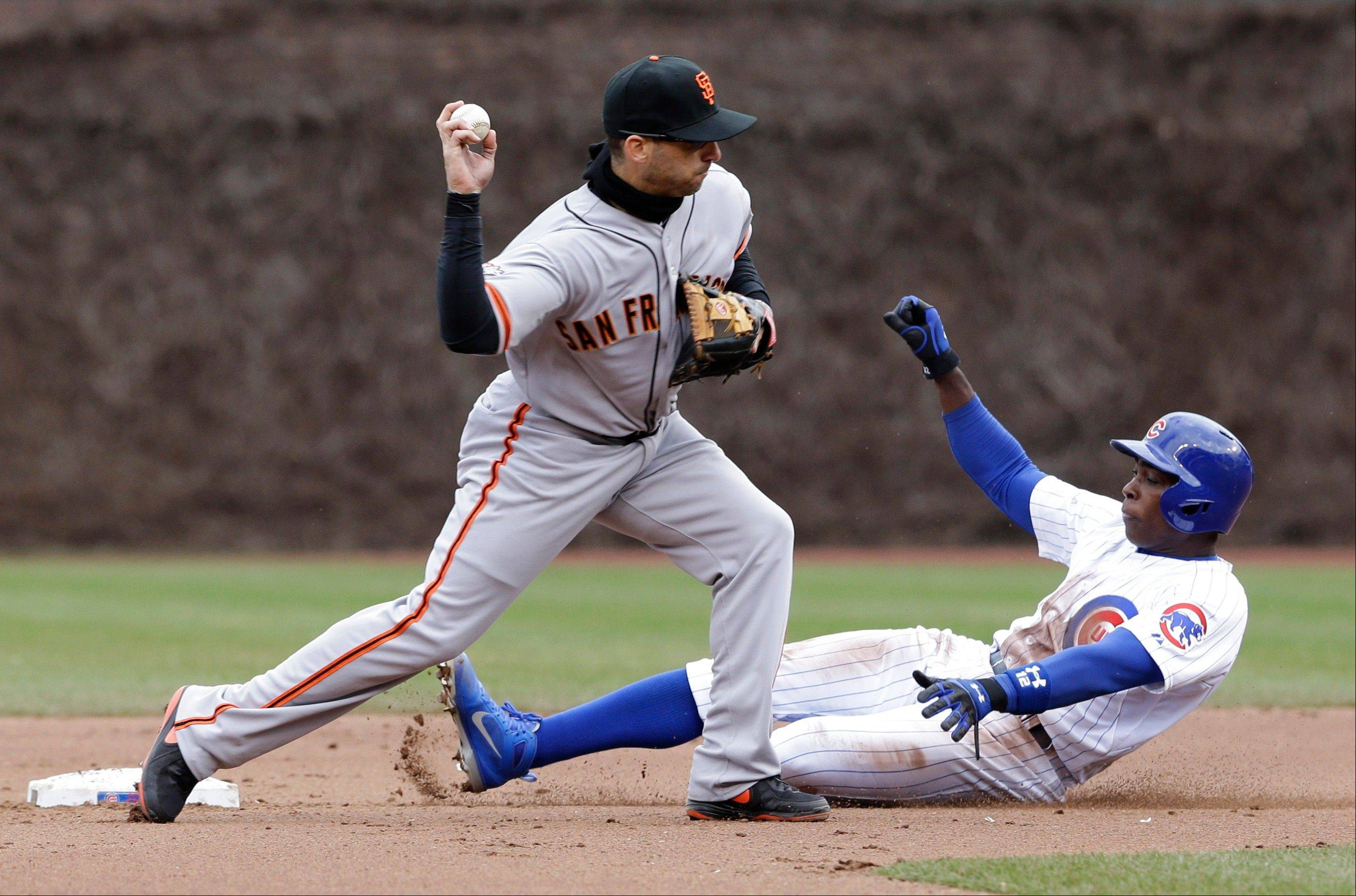 San Francisco Giants second baseman Marco Scutaro, left, throws to first after forcing out Chicago Cubs' Alfonso Soriano during the fourth inning of a baseball game Saturday in Chicago. Scott Hairston was safe at first.