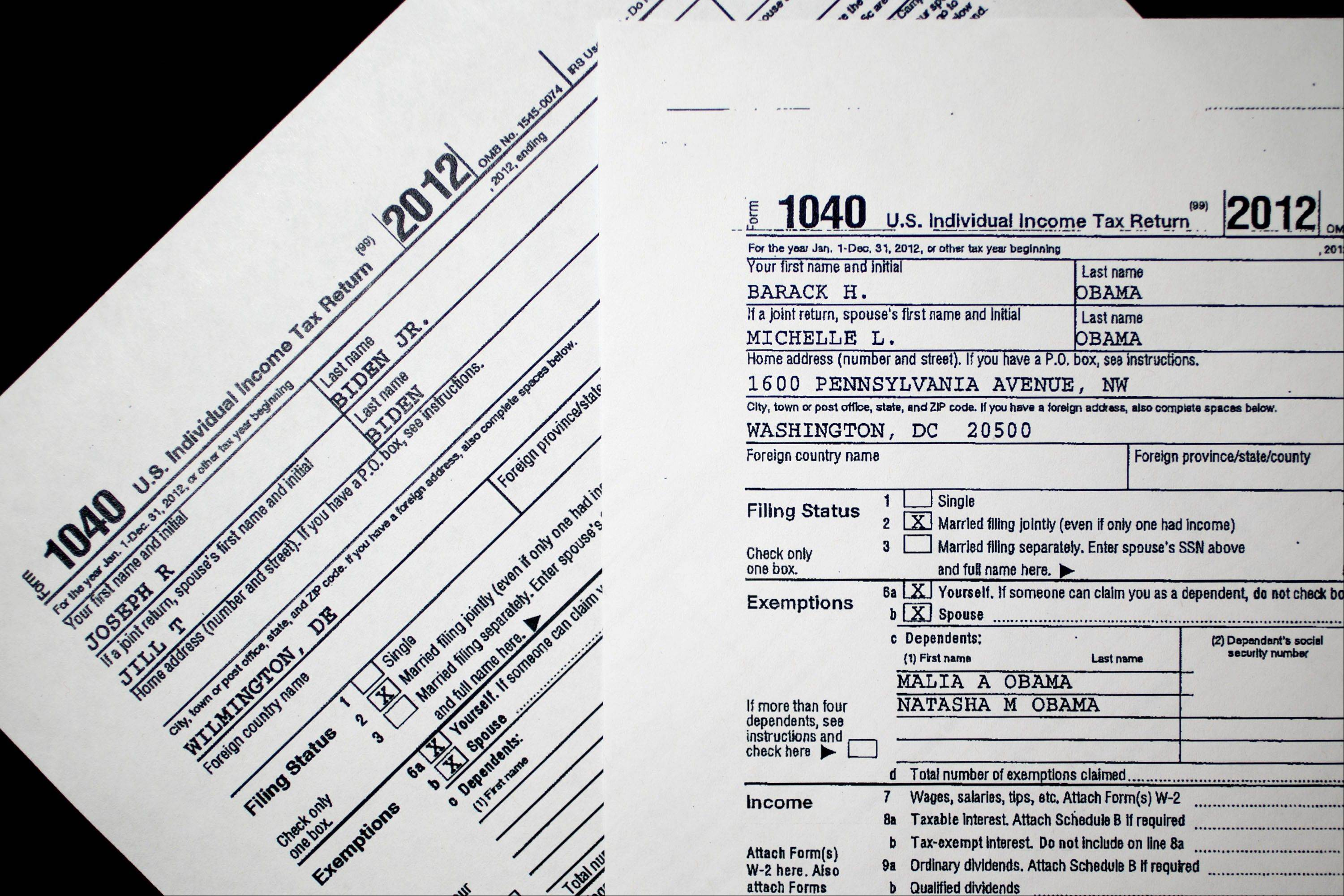 Copies of the U.S. Department of the Treasury Internal Revenue Service 1040 Individual Income Tax form for the 2012 tax year belonging to U.S. President Barack Obama and first lady Michelle Obama and U.S. Vice President Joseph Biden and his wife, Jill Biden, are arranged for a photograph Friday in Washington, D.C.