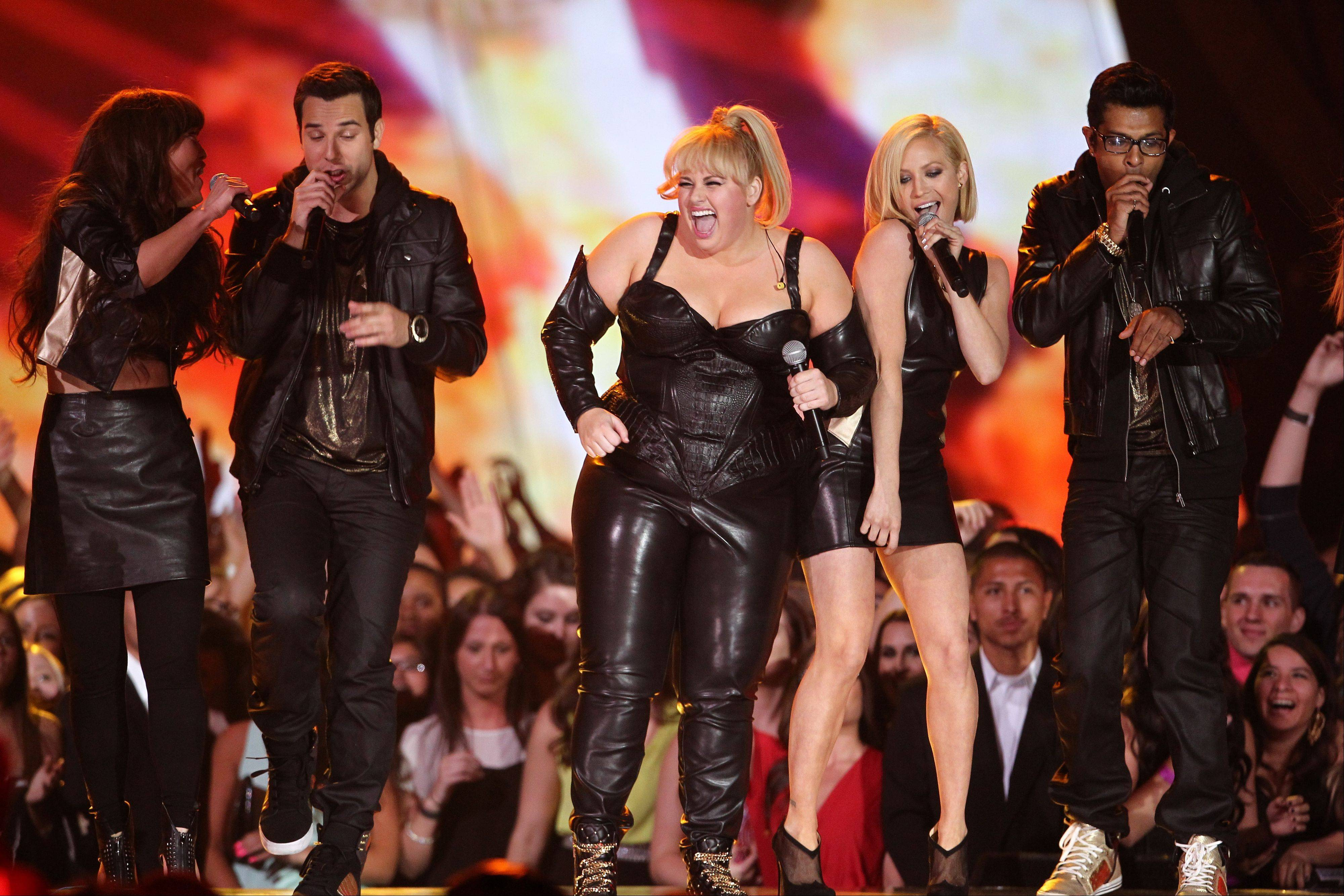 Host Rebel Wilson and the cast of �Pitch Perfect� perform onstage at the MTV Movie Awards in Sony Pictures Studio Lot in Culver City, Calif., on Sunday April 14, 2013.
