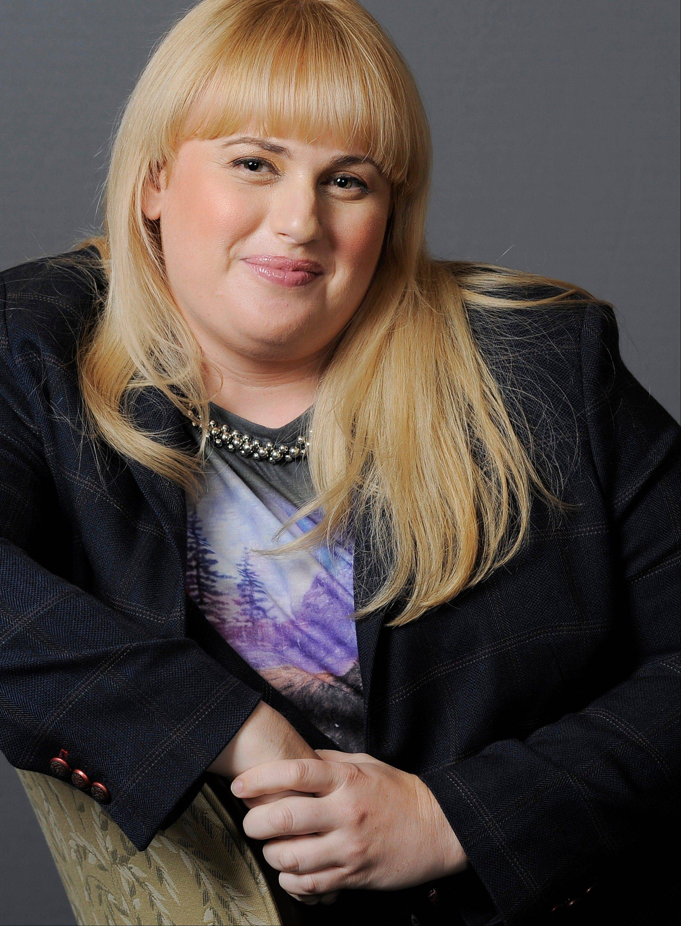 Actress, writer and comedienne Rebel Wilson sings, dances and summons laughs — and that's just in the opening moments of the upcoming MTV Movie Awards Sunday. The Australian actress is hosting the show, and she's set to start the ceremony by singing solo.