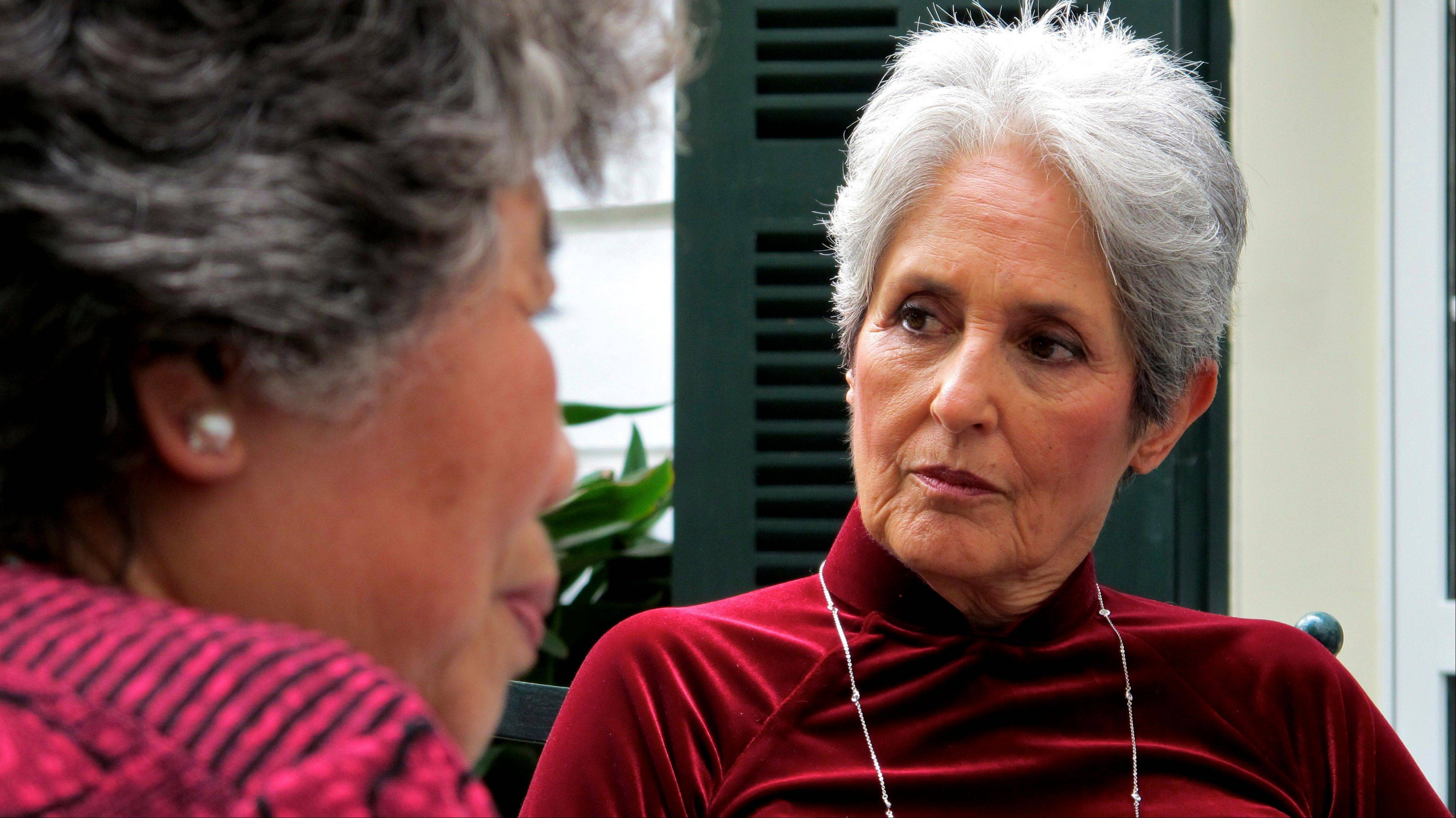 Joan Baez listens to former staff of the Metropole Hanoi discuss their memories of working at the hotel in 1972 in Hanoi, Vietnam. The folk singer and social activist visited Vietnam recently for the first time since she came to the country in December 1972 as part of an American peace delegation.