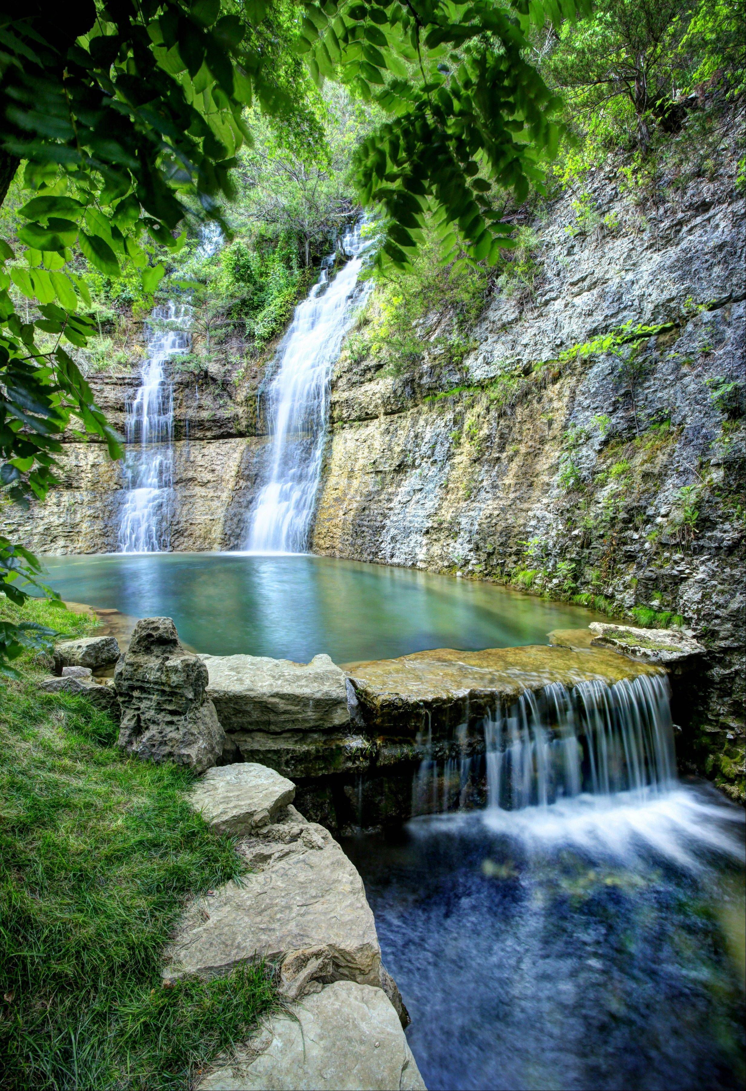 Waterfalls and rock bluffs make Dogwood Canyon a soothing back-to-nature retreat near Branson, Mo.