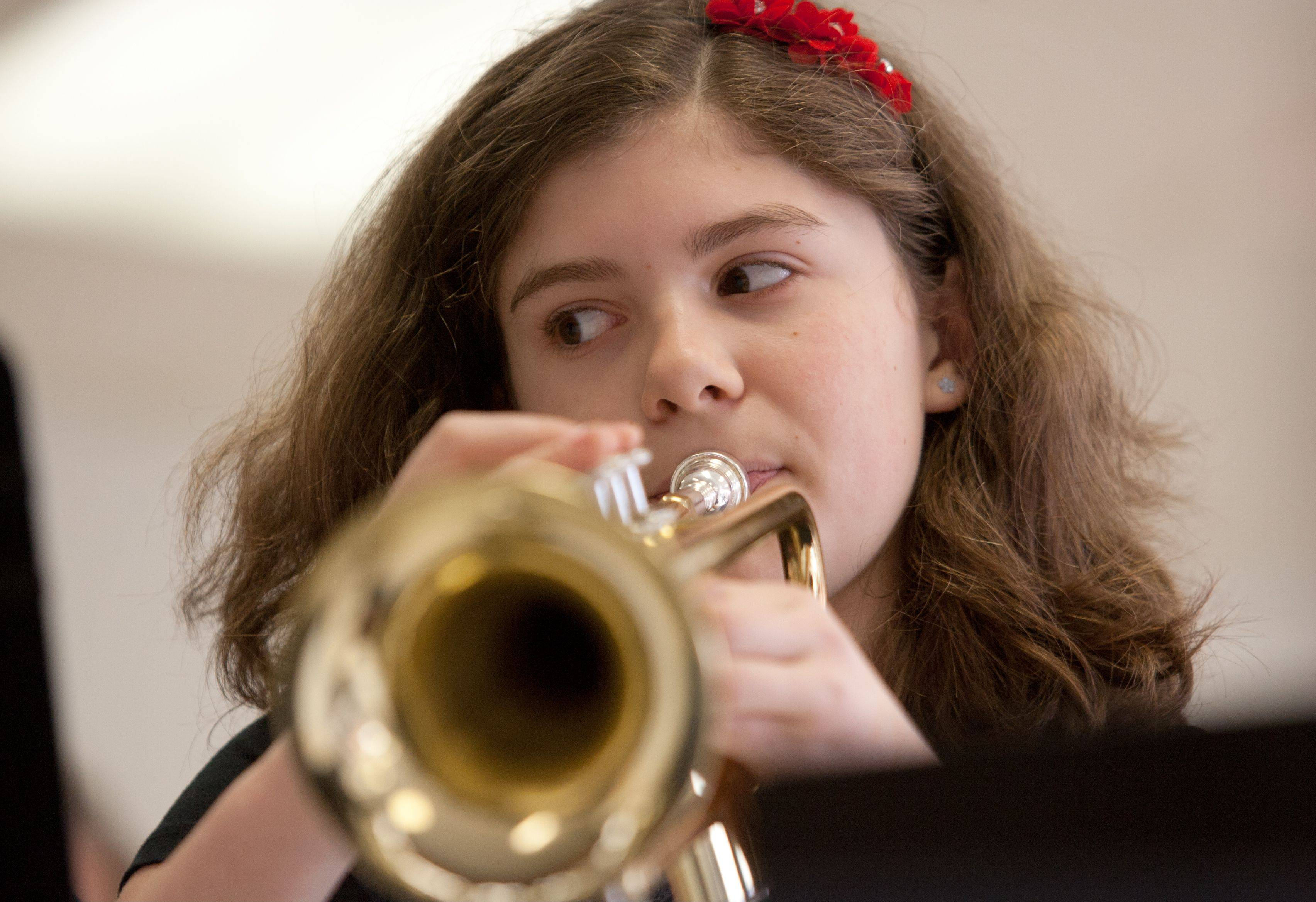 Mackenna Clayton, 11, of Lombard plays her trumpet during the Lombard Elementary District 44 Music Parent association's hosting of its 52nd annual pancake breakfast, held at Westlake Middle School.