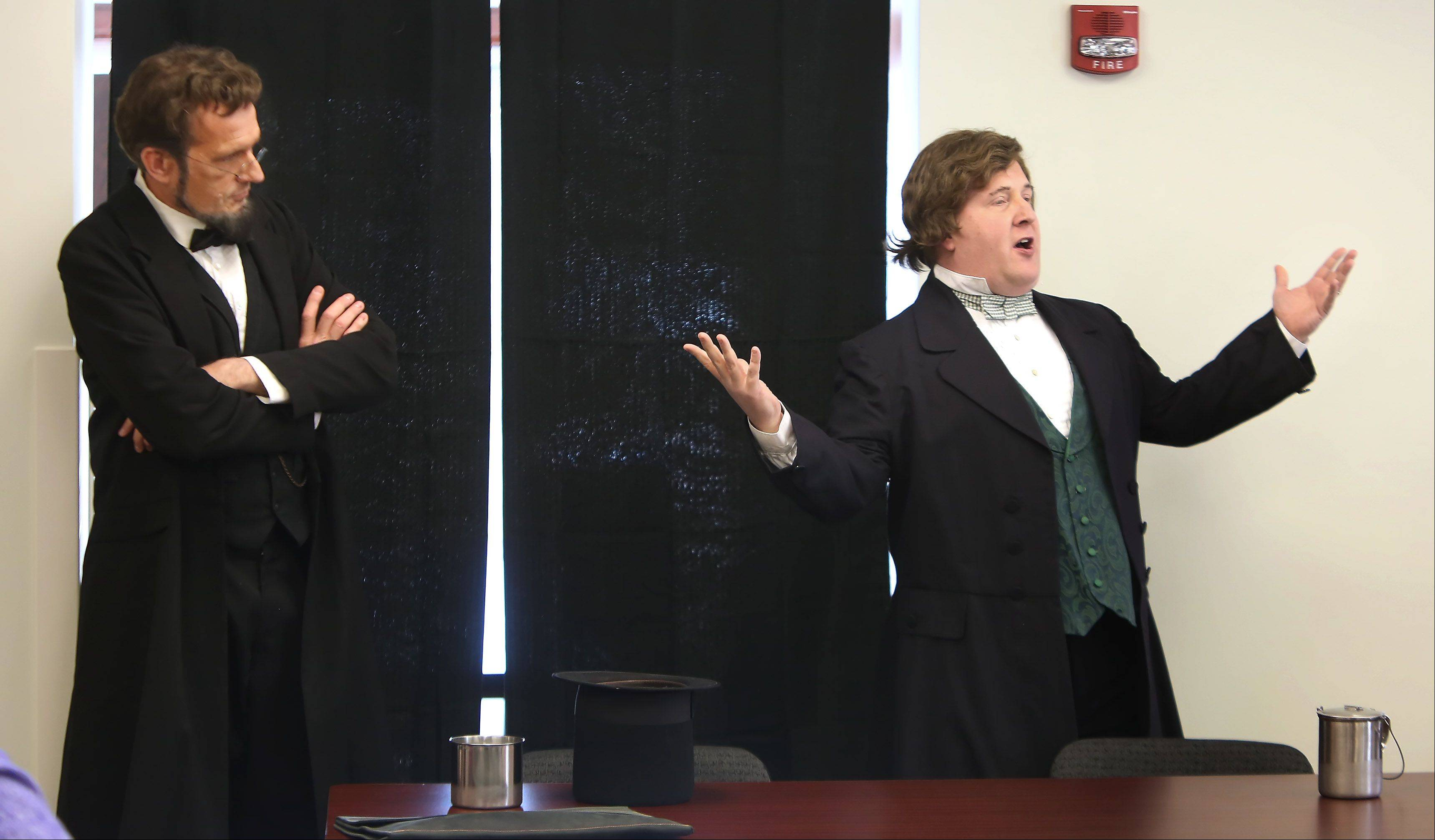 "Abraham Lincoln, played by George Buss, watches as Stephen A. Douglas, played by Timothy Connors, discusses his part in the debates they held during their run for the U.S. Senate Sunday at the Grayslake Heritage Center. It's part of an exhibit called ""Abraham Lincoln: Self Made in America."""