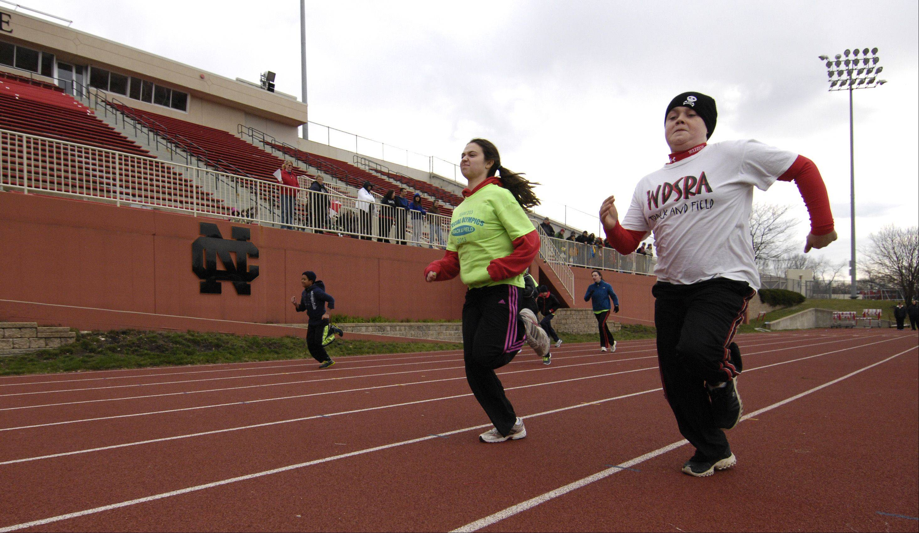 Jordan Pfauth, 13, of Carol Stream takes the inside lane in the 100-meter dash Sunday during the Western DuPage Special Recreation Association annual track and field meet at North Central College in Naperville. About 140 young athletes took part in the event.