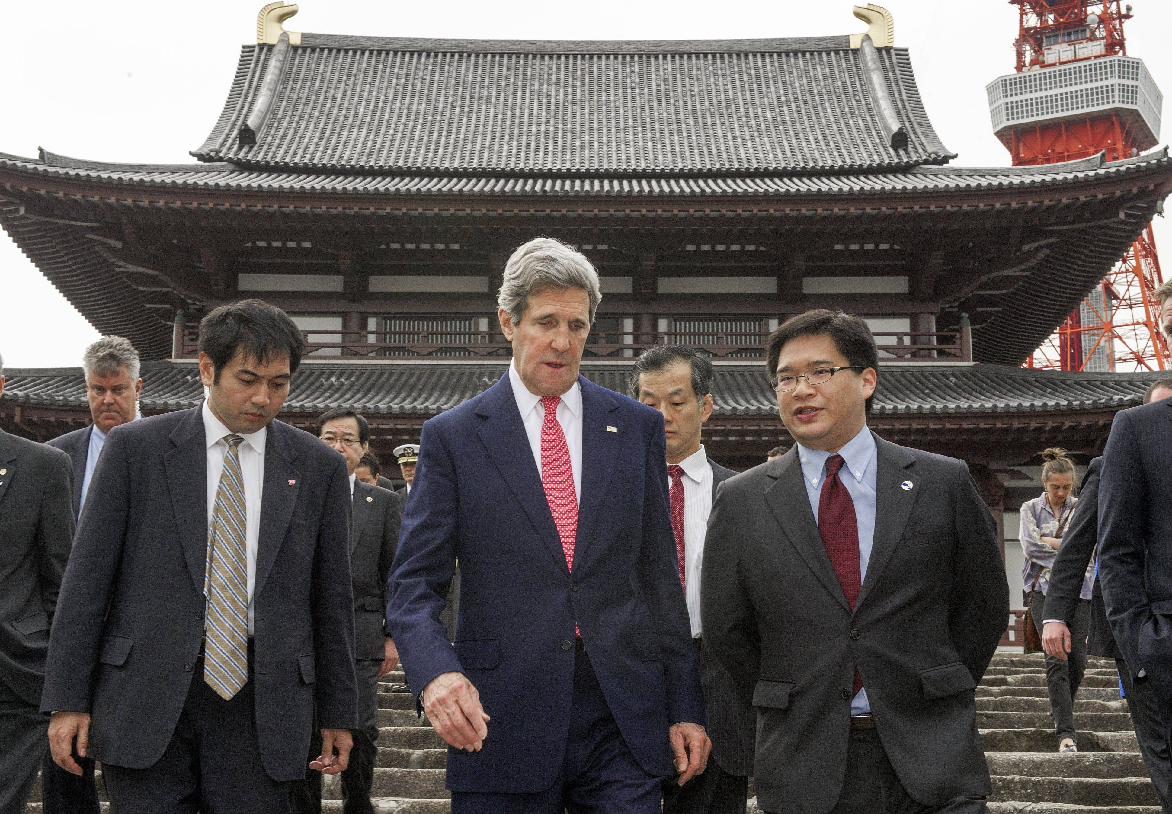 U.S. Secretary of State John Kerry, center, tours the Zojoji Buddhist temple in Tokyo Sunday. The United States and Japan on Sunday offered new talks with North Korea to resolve the increasingly dangerous standoff over its nuclear and missile programs, but said the reclusive communist government first must lower tensions and honor previous agreements.