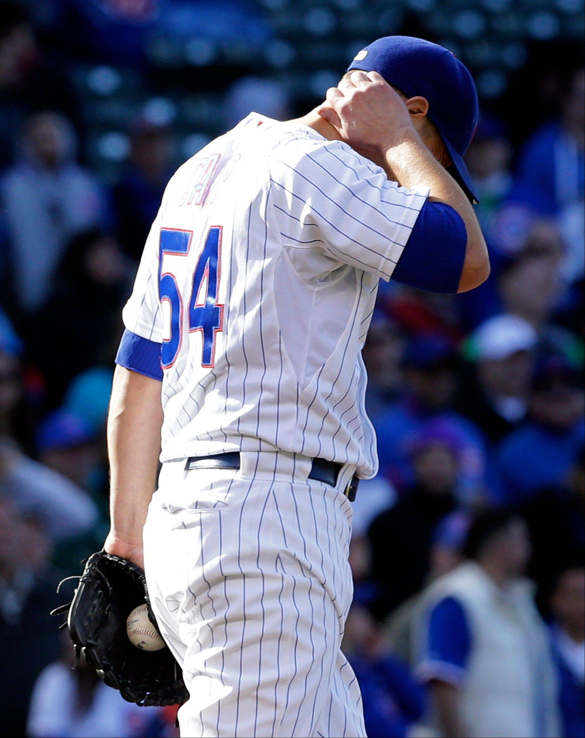 Chicago Cubs relief pitcher Shawn Camp reacts after San Francisco Giants� Hunter Pence hit a solo home run during the ninth inning of a baseball game in Chicago, Sunday, April 14, 2013. The Giants won 10-7.